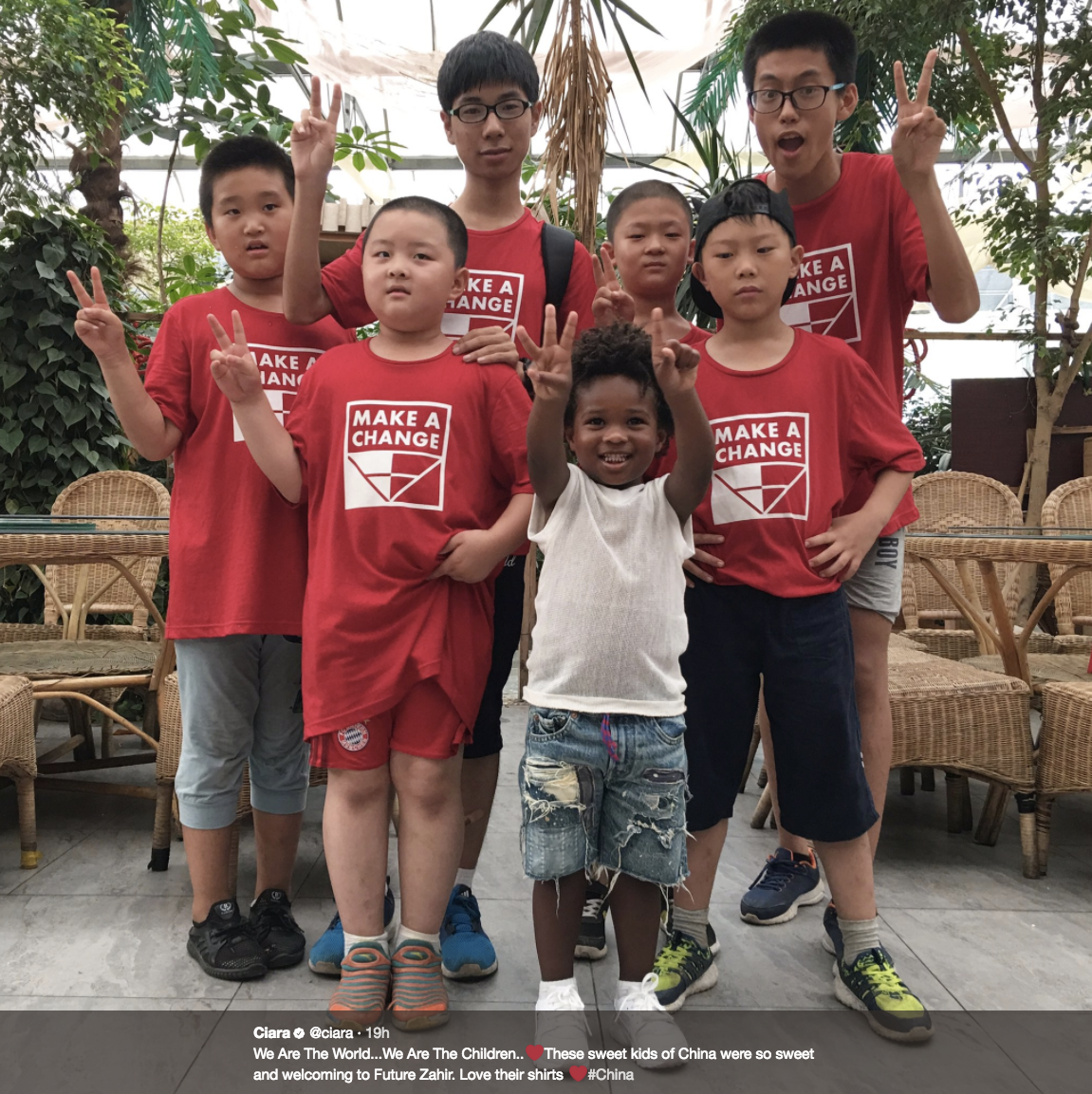 """We Are The World...We Are The Children..These sweet kids of China were so sweet and welcoming to Future Zahir. Love their shirts #China""                      The entire Wilson family has been traveling around China on vacation before training camp starts back in Seattle next week! Ciara, Russell, Sienna and Future spent time at Disneyland Shanghai, the Great Wall, shopping in local markets, and doing multiple photoshoots (they are the Wilsons, after all)! Russell was there in part as a rep for Nike, and spent time at their Shanghai campus doing drills with local children (and Future Jr.!) and ""bringing football to China"".  (Image: @ciara / twitter.com/ciara)"