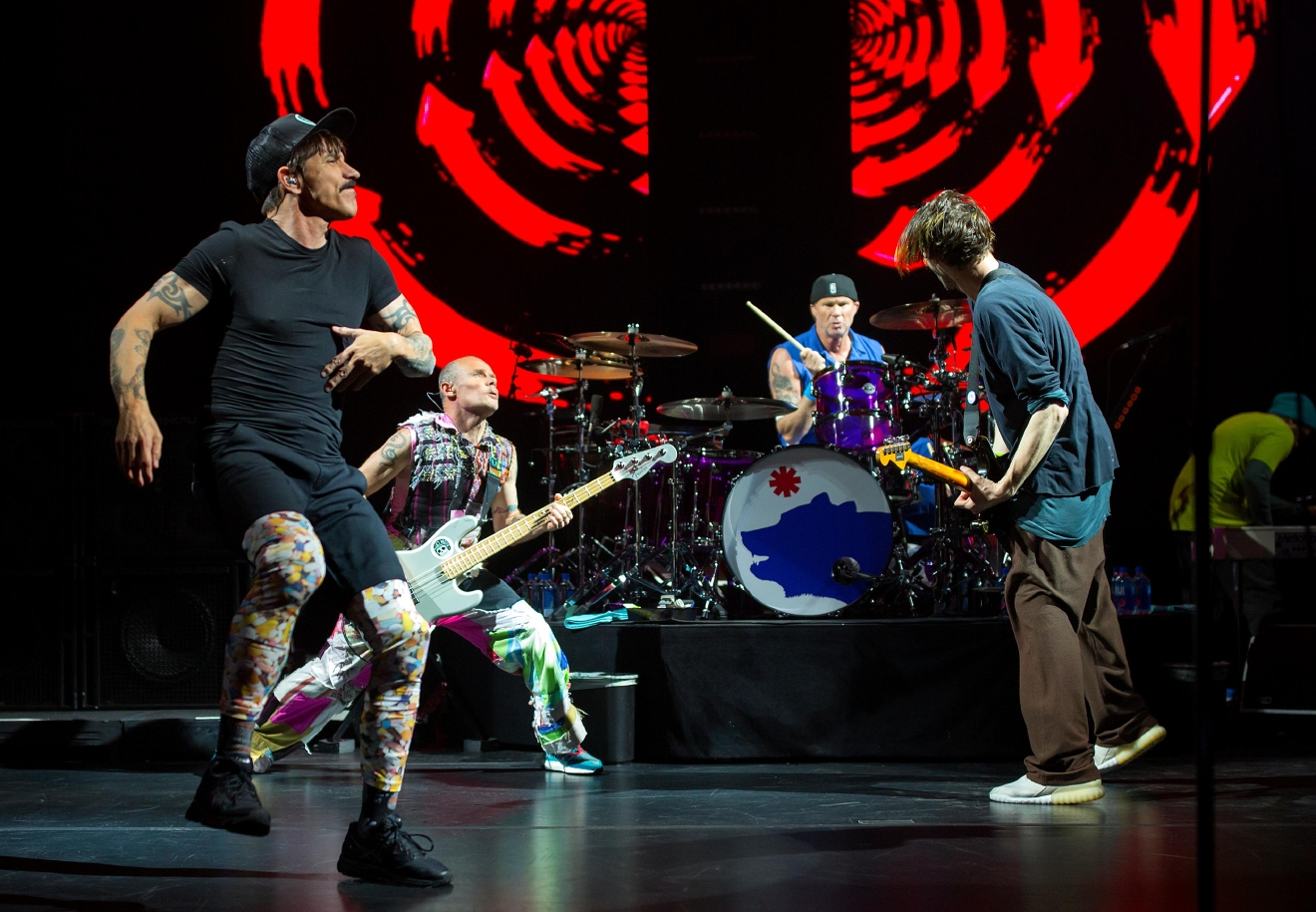 (Left to right) Lead singer Anthony Kiedis, bassist Flea, drummer Chad Smith, and guitarist Josh Klinghoffer, during the Red Hot Chili Peppers' performance at KeyArena. (Sy Bean / Seattle Refined)