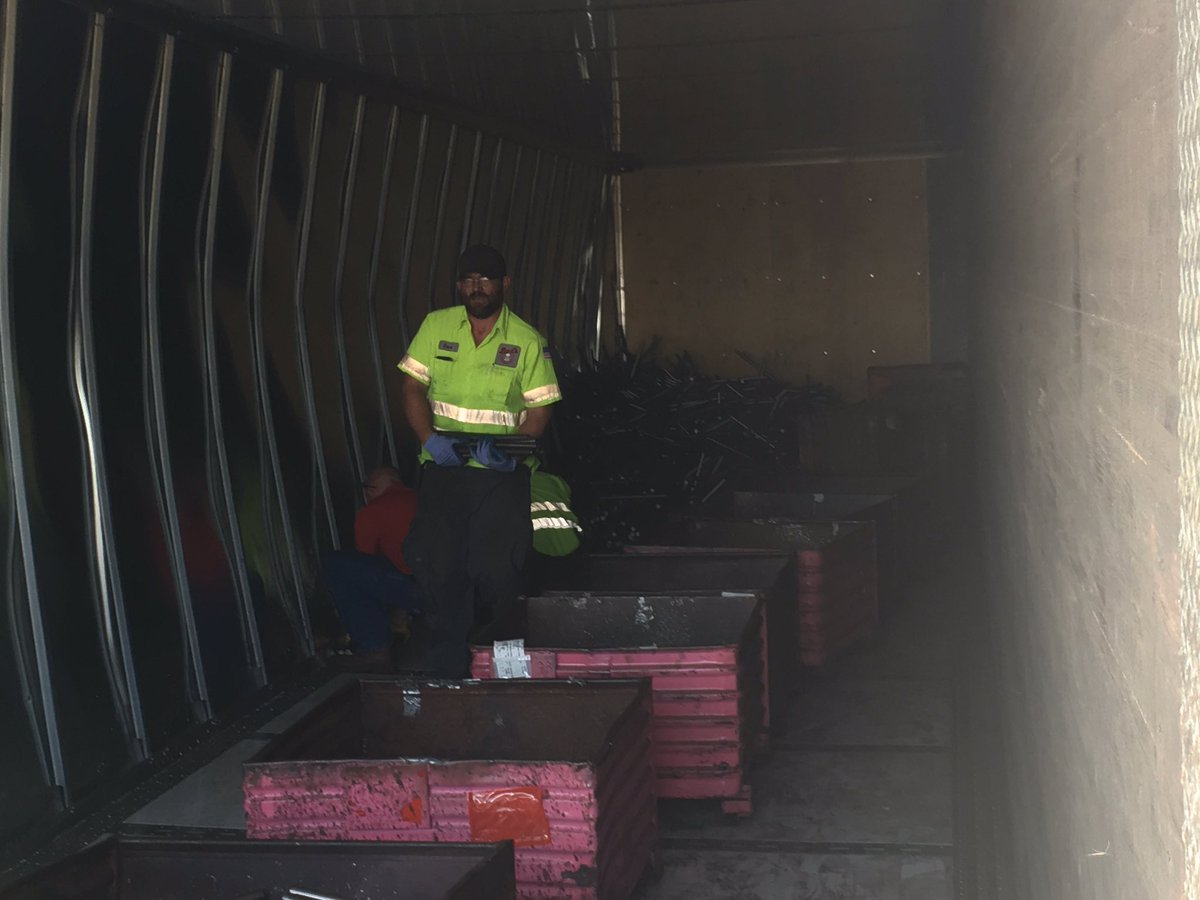 Semi carrying steel bars flipped on side closing I-69 on-ramp.  (WWMT/Mike Krafick)