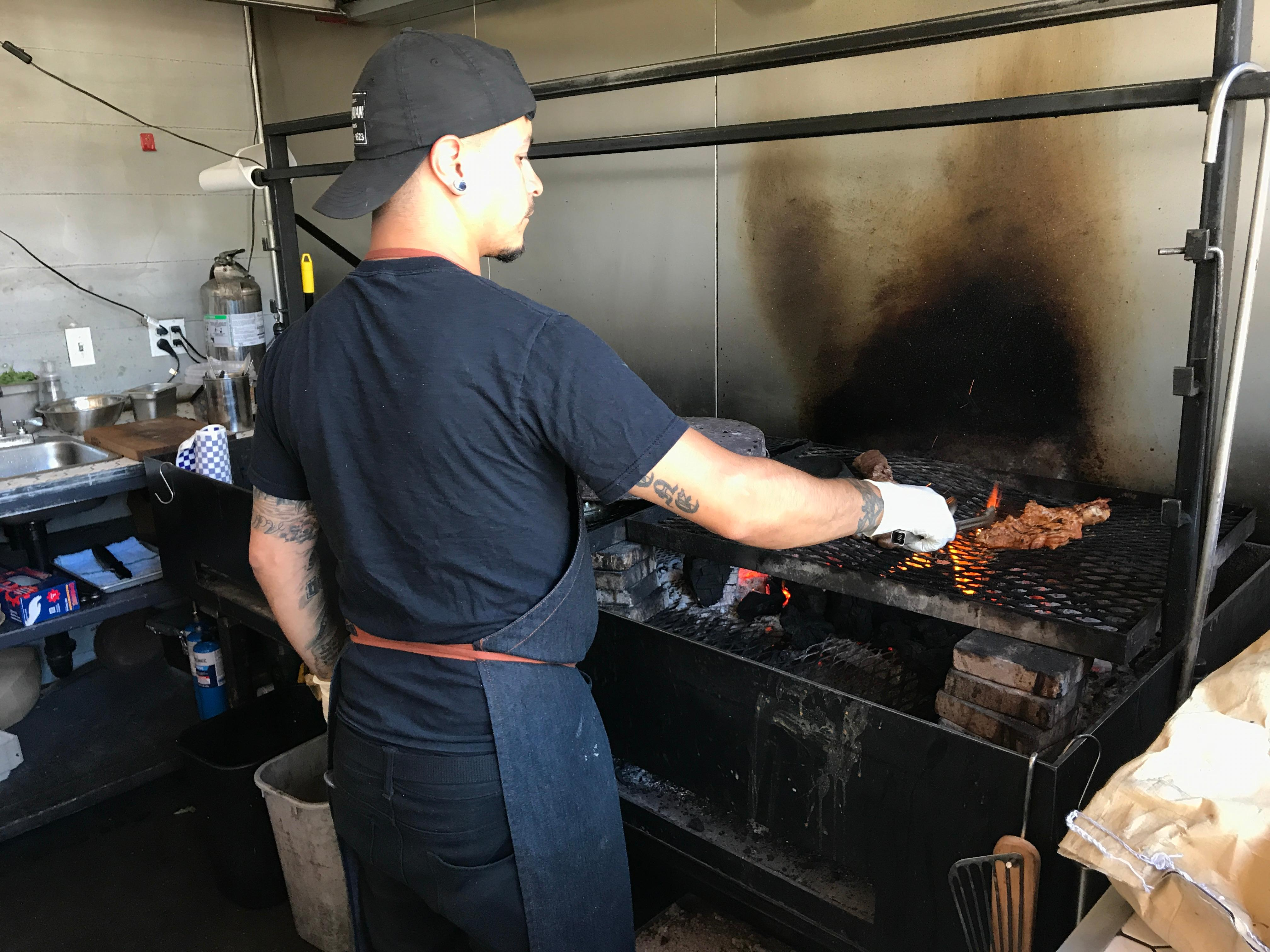 Manning the Ciudad grill. (Image: Frank Guanco)
