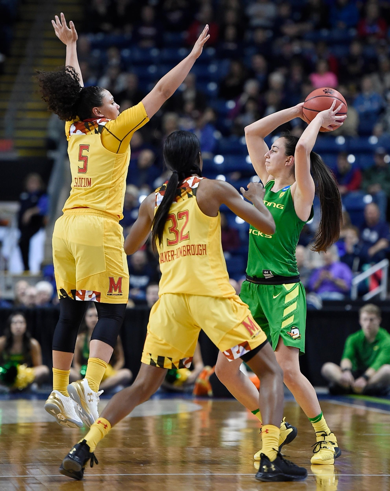 Maryland's Destiny Slocum, left, and Shatori Walker-Kimbrough, center, pressure Oregon's Maite Cazorla, right, during the first half of a regional semifinal game in the NCAA women's college basketball tournament, Saturday, March 25, 2017, in Bridgeport, Conn. (AP Photo/Jessica Hill)