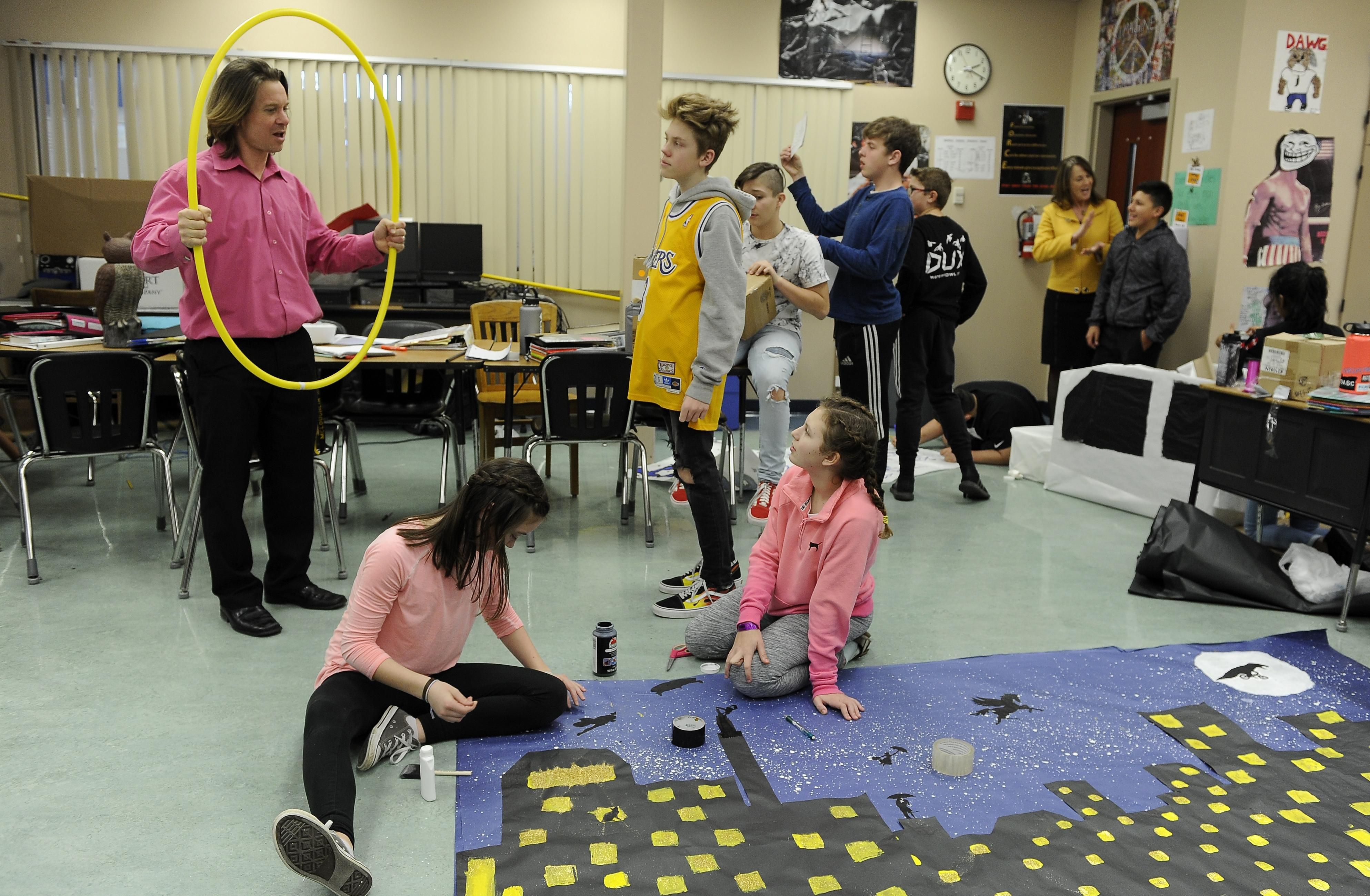 McLoughlin Middle School teacher Adam Drew brainstorms poster ideas with students for an upcoming dance. [Mail Tribune / Andy Atkinson]