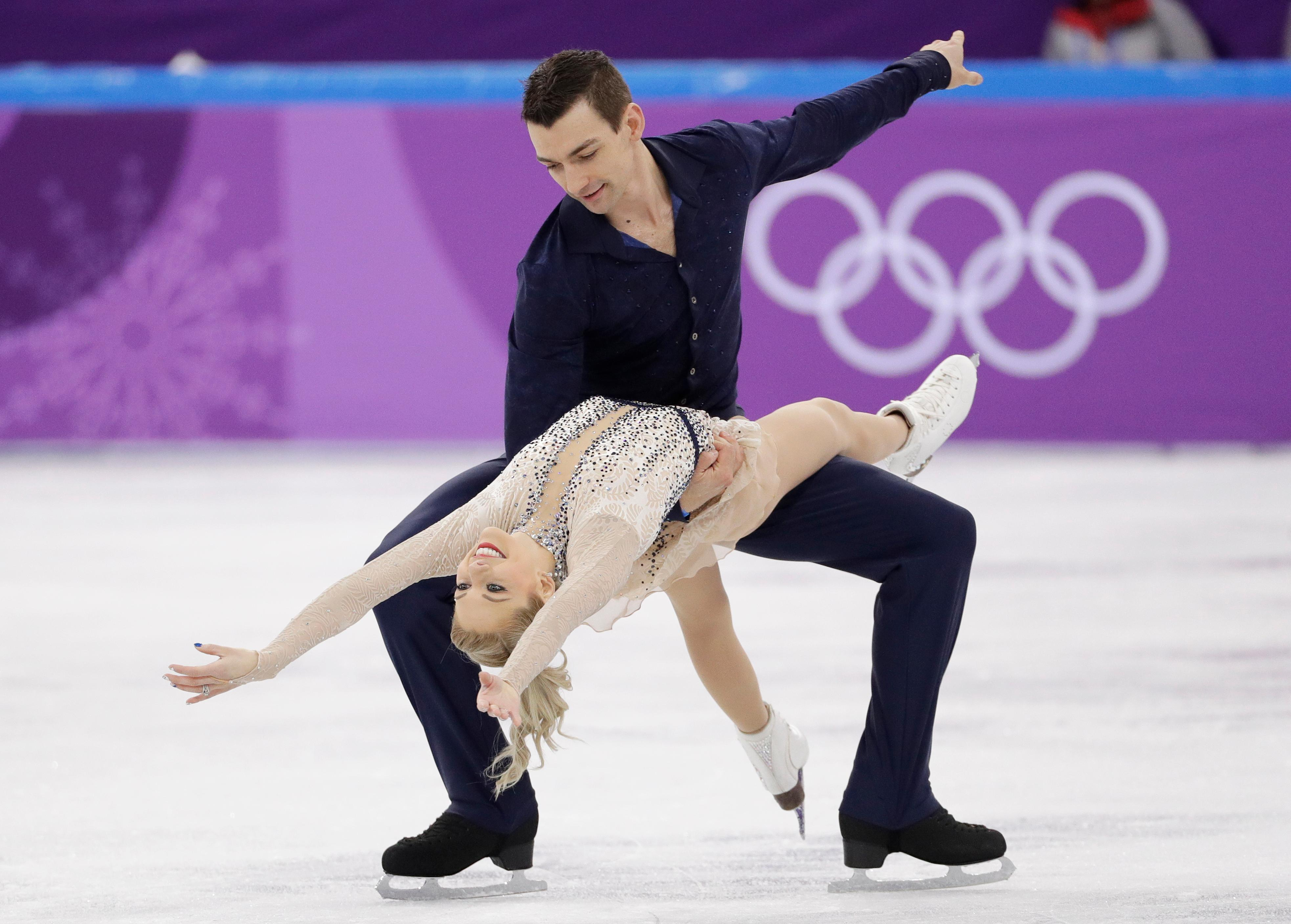 FILE - In this Feb. 14, 2018, file photo, Alexa Scimeca Knierim and Chris Knierim perform in the pairs figure skating short program in the Gangneung Ice Arena at the 2018 Winter Olympics in Gangneung, South Korea. For the season following an Olympics, Skate America certainly is packed with top U.S. competitors. The six-event Grand Prix series begins in Everett, Washington on Friday, Oct. 19. (AP Photo/David J. Phillip, File)