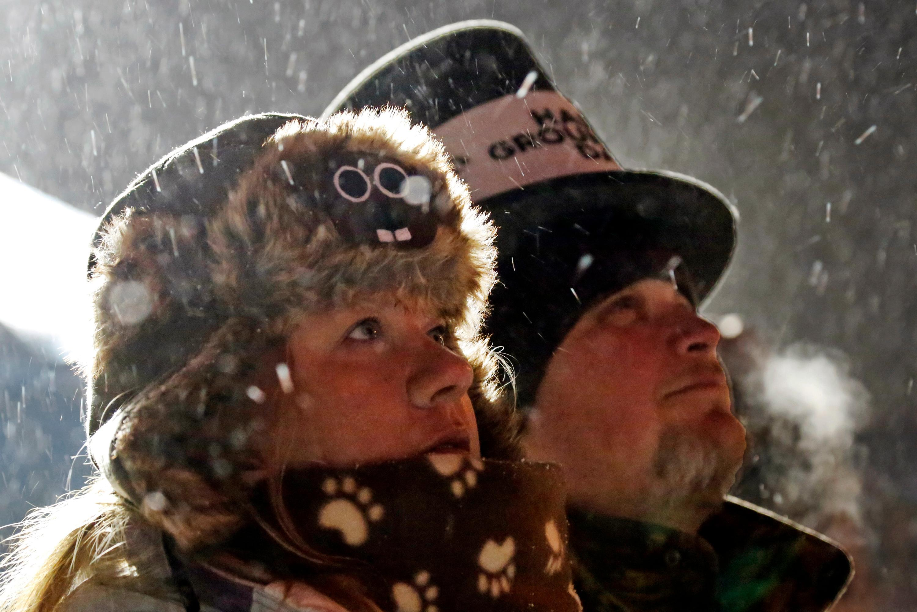 Jackie and Jimmy Wilson watch a fireworks display during the 132nd Groundhog Day on Gobbler's Knob in Punxsutawney, Pa. Friday, Feb. 2, 2018. (AP Photo/Gene J. Puskar)