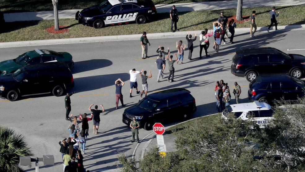 <p>FILE - In this Feb. 14, 2018 file photo, students hold their hands in the air as they are evacuated by police from Marjory Stoneman Douglas High School in Parkland, Fla., after a shooter opened fire on the campus. A sheriff's office captain told deputies to form a perimeter instead of confronting the gunman at the high school where several people were killed in a mass shooting, according to documents obtained by the Miami Herald. The newspaper reported late Thursday, March 1, that it had obtained a partial Broward Sheriff's Office dispatch log, which showed that Capt. Jan Jordan gave the order for deputies to establish a perimeter. (Mike Stocker/South Florida Sun-Sentinel via AP)<br></p>