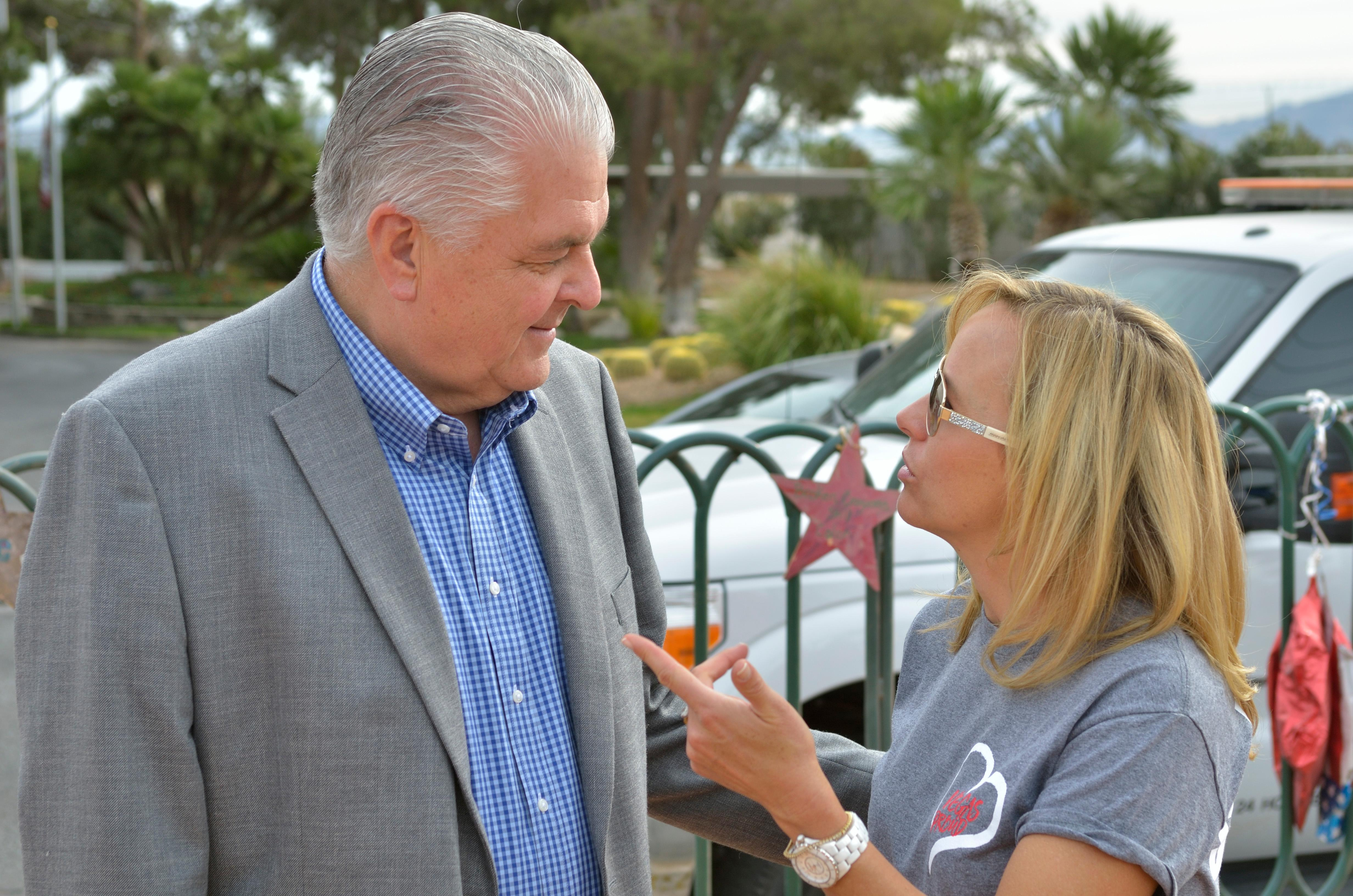 "Clark County Commissioner Steve Sisolak, left, speaks with Mynda Smith during ""Greg Zanis Day"" at the Welcome to Fabulous Las Vegas sign on the Las Vegas Strip on Sunday, Nov. 12, 2017. Zanis, a carpenter from Aurora, Ill., was recognized by the Clark County Commision for creating 58 crosses memorializing those who died during the Route 91 Harvest festival shooting on Oct. 1, one of whom was Smith's sister Neysa Tonks. The crosses were later moved to the Clark County Museum for its permanent collection. [Bill Hughes/Las Vegas News Bureau]"