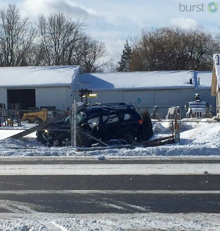 Police say a driver traveling southbound on Saginaw Street lost control and hit a power line in Grand Blanc Township. The power line fell over onto the SUV and across Saginaw Street pinning the driver inside their vehicle. (WEYI/WSMH)