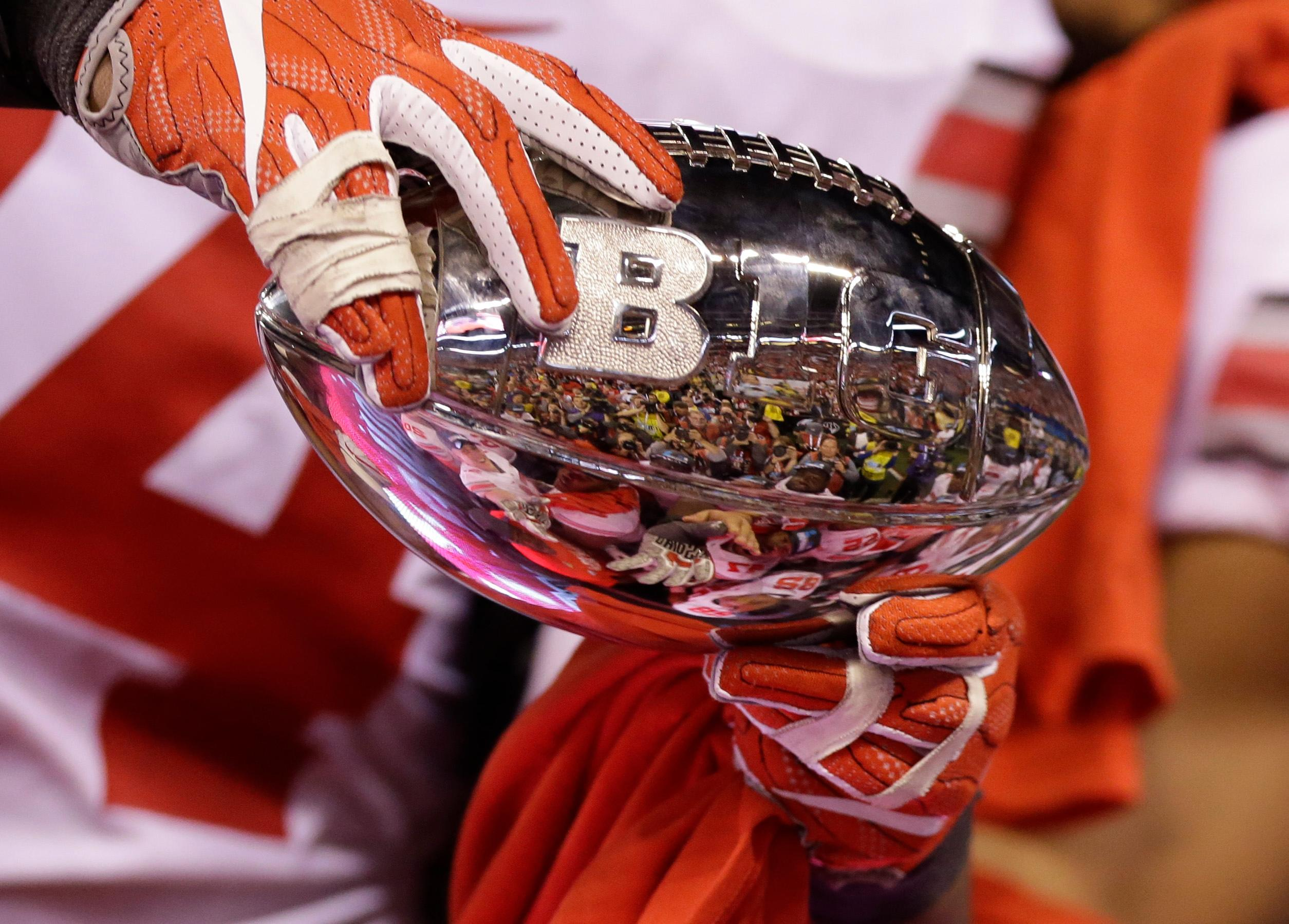 Ohio State players hold the championship trophy following the Big Ten championship NCAA college football game against Wisconsin, early Sunday, Dec. 3, 2017, in Indianapolis. Ohio State won 27-21. (AP Photo/AJ Mast)