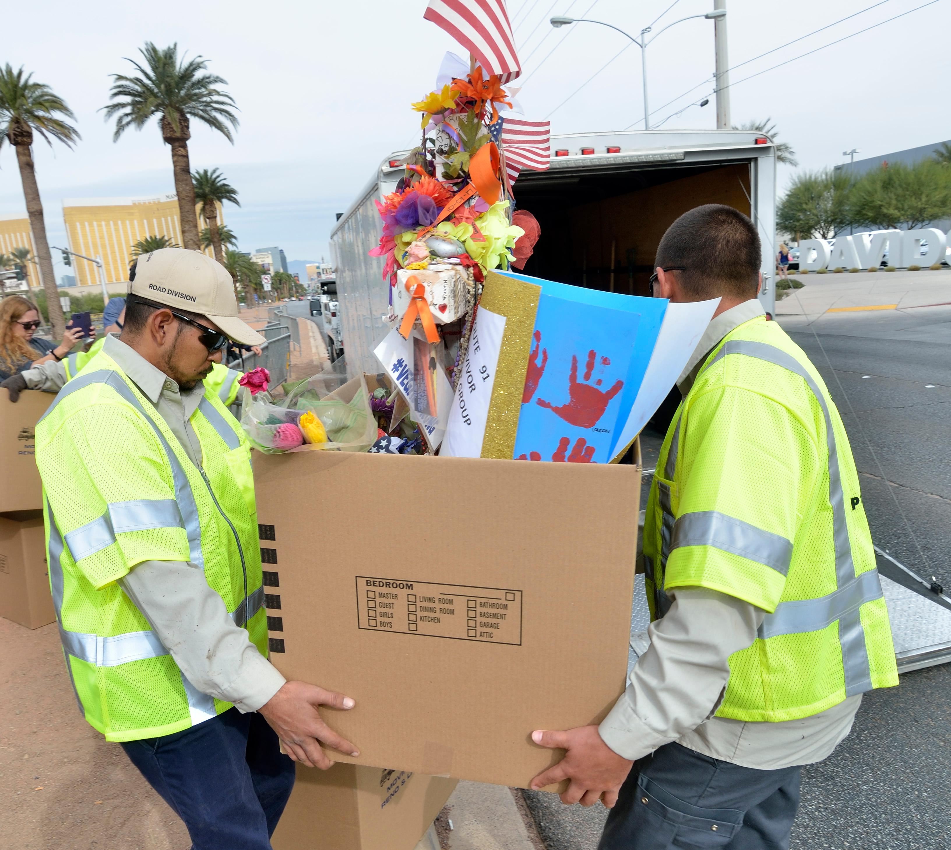 "Clark County workers move memorial crosses during ""Greg Zanis Day"" at the Welcome to Fabulous Las Vegas sign on the Las Vegas Strip on Sunday, Nov. 12, 2017. Zanis, a carpenter from Aurora, Ill., was recognized by the Clark County Commision for creating 58 crosses memorializing those who died during the Route 91 Harvest festival shooting on Oct. 1. The crosses were moved to the Clark County Museum for its permanent collection. [Bill Hughes/Las Vegas News Bureau]"