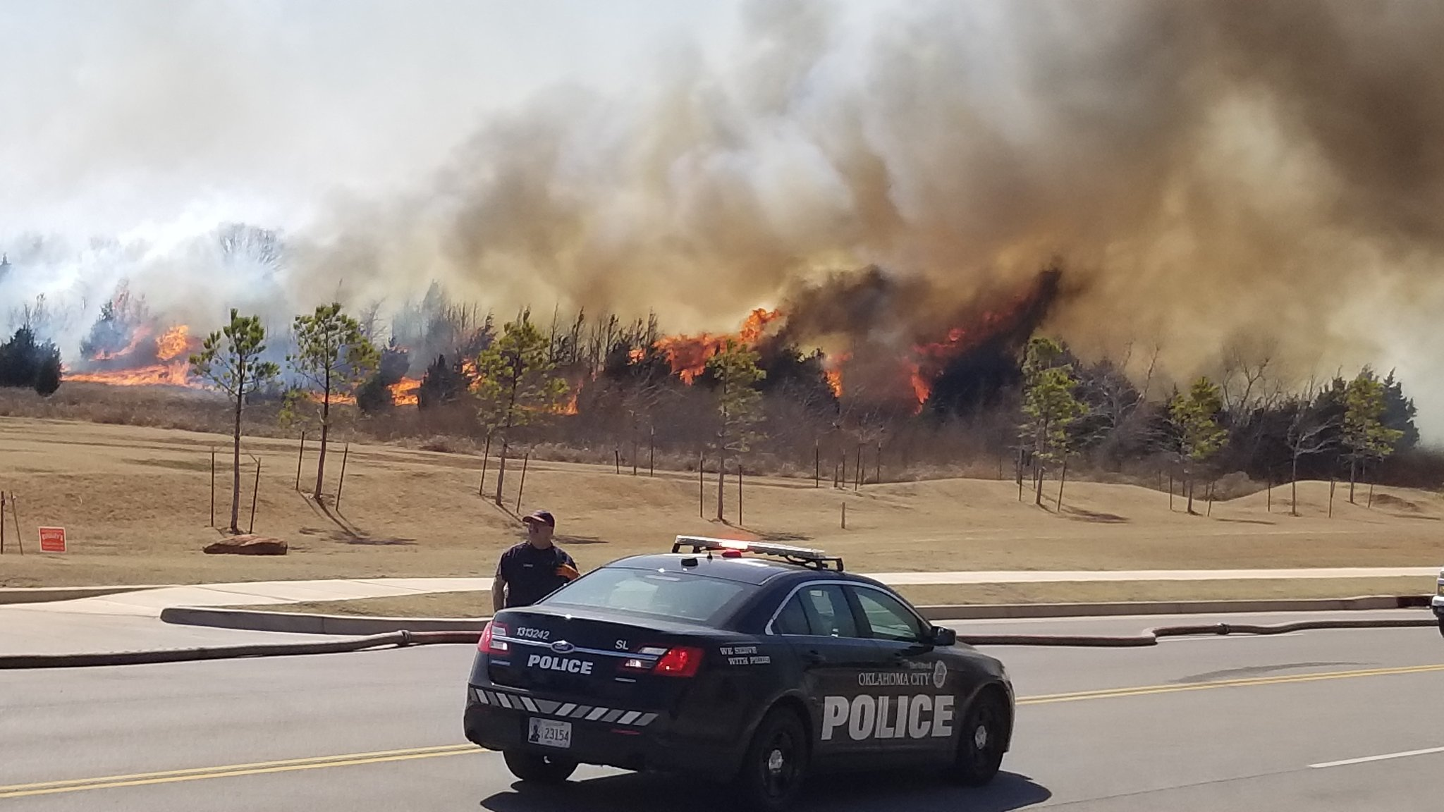 A grass fire burns March 15 near N. Kelley and Hefner in Oklahoma City. (KOKH/Steven Anderson)