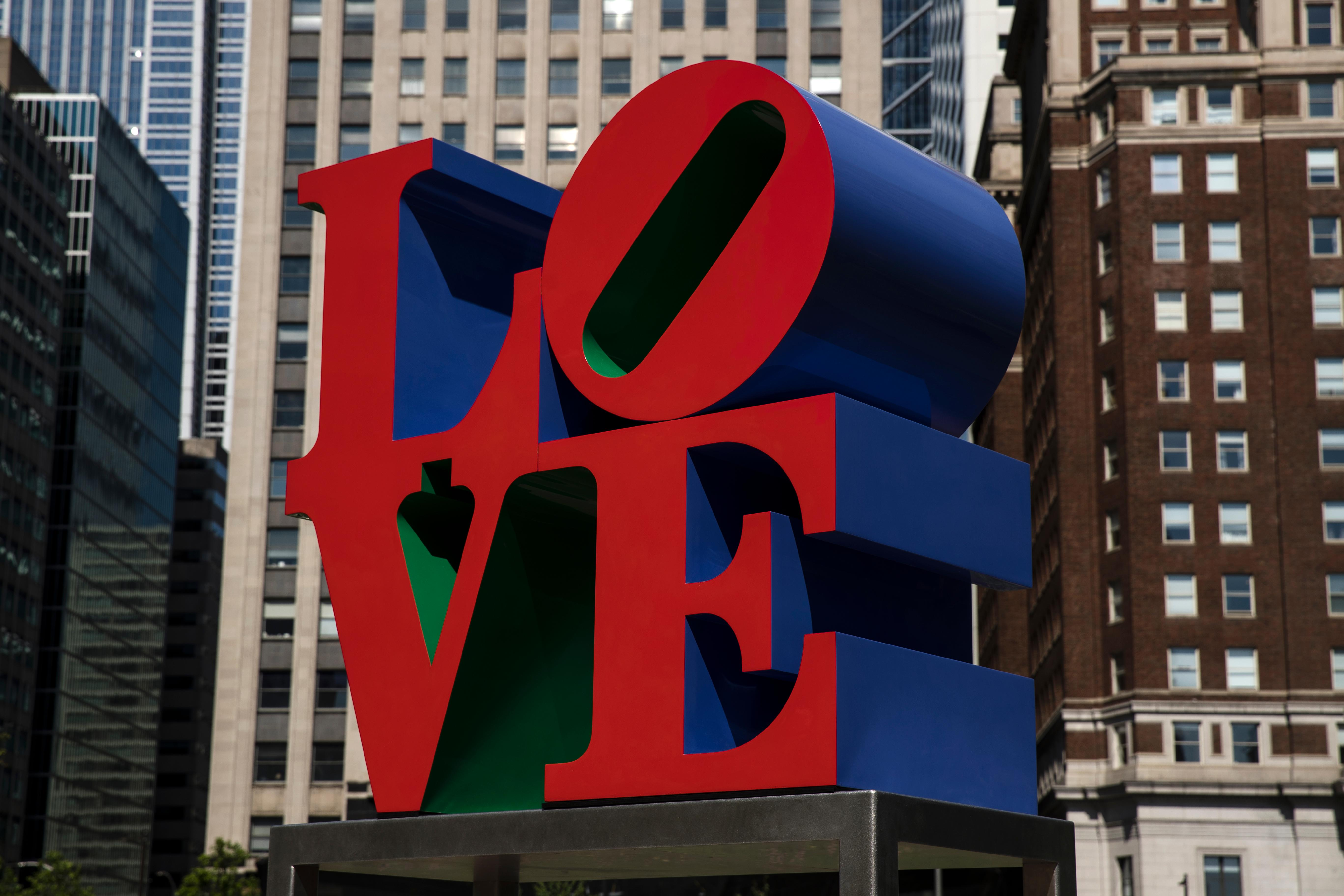 "Shown is the Robert Indiana sculpture ""LOVE"" in John F. Kennedy Plaza, commonly known as Love Park, in Philadelphia, Monday, May 21, 2018. Indiana, best known for his 1960s LOVE series, died from respiratory failure Saturday, May 19, 2018, at his home in Maine, Indiana's attorney said. He was 89. (AP Photo/Matt Rourke)"