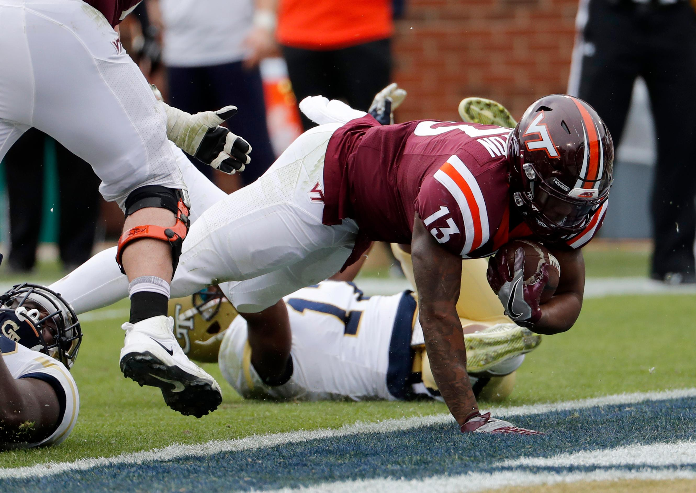 Virginia Tech's Jalen Holston, right, scores a touchdown in the third quarter of an NCAA college football game against Georgia Tech in Atlanta, Saturday, Nov. 11, 2017. Georgia Tech beat Virginia Tech 28-22. (AP Photo/David Goldman)