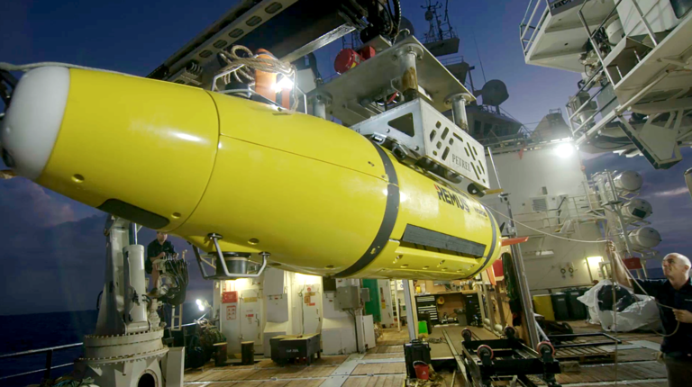 The AUV returns to the R/V Petrel. The autonomous underwater vehicle can operate on a submerged run for up to 20 hours. Photo courtesy of Paul G. Allen.