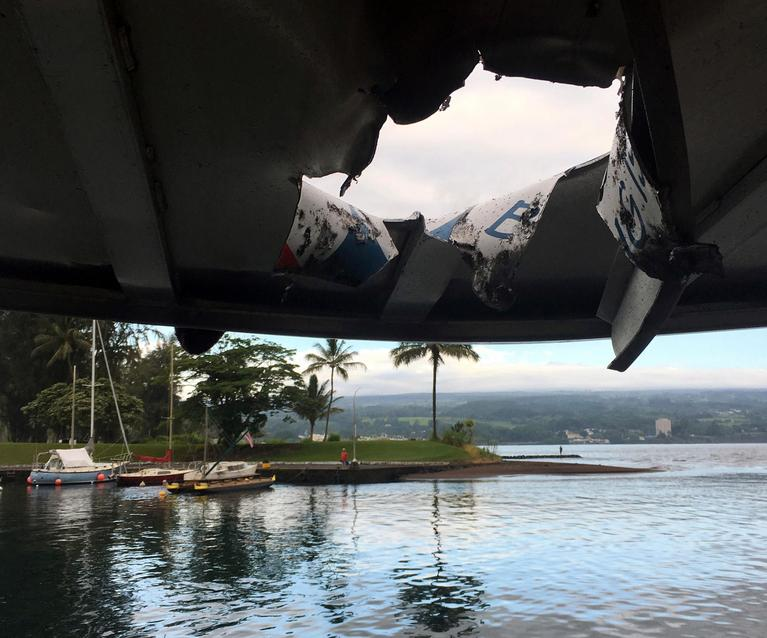 This photo provided by the Hawaii Department of Land and Natural Resources shows damage to the roof of a tour boat after an explosion sent lava flying through the roof off the Big Island of Hawaii Monday, July 16, 2018, injuring at least 23 people.(Hawaii Department of Land and Natural Resources via AP)