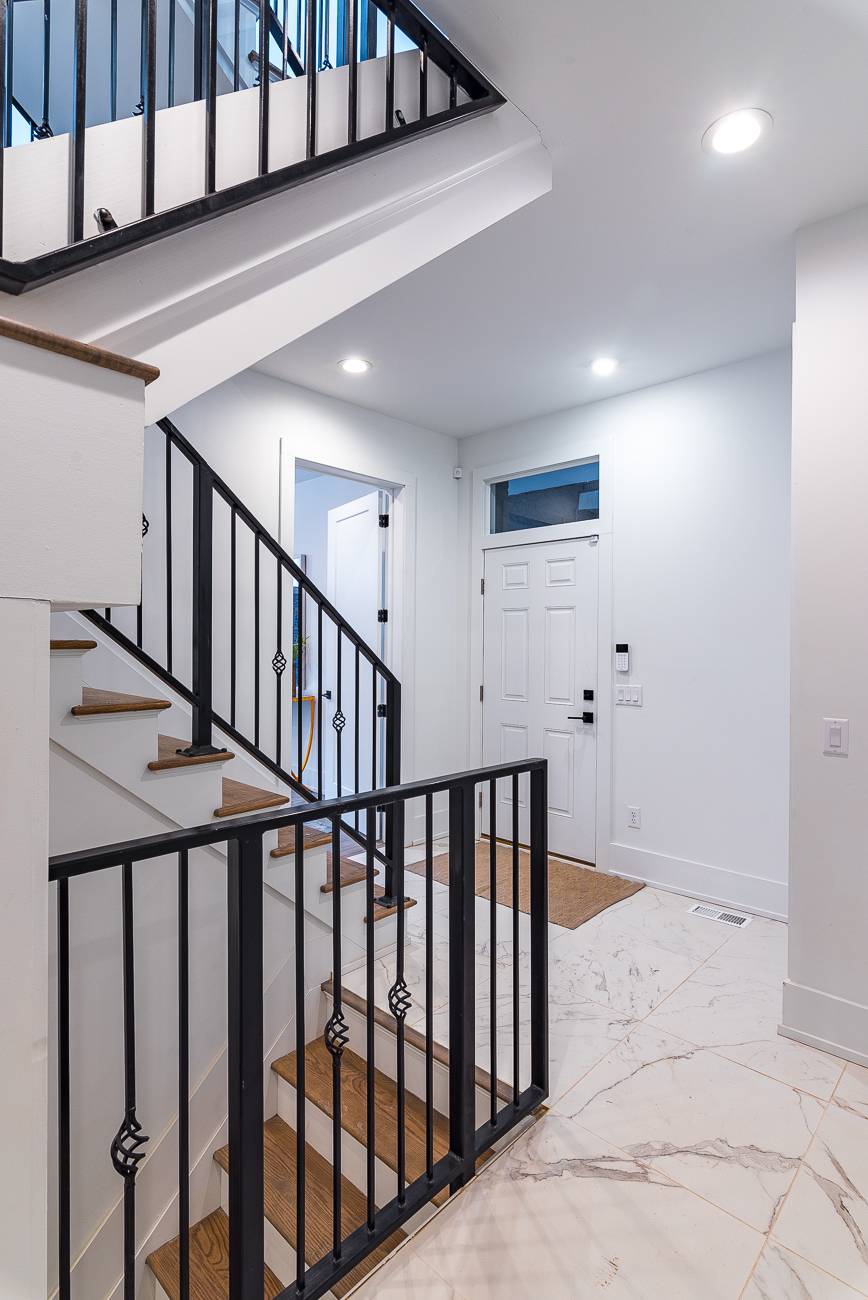 A breezeway door opens to the first floor of the house. From there, you can go down to the unfinished basement, or up to the kitchen/living room/master bedroom. The second bedroom is on the first floor. / Image: Phil Armstrong, Cincinnati Refined // Published: 2.4.19