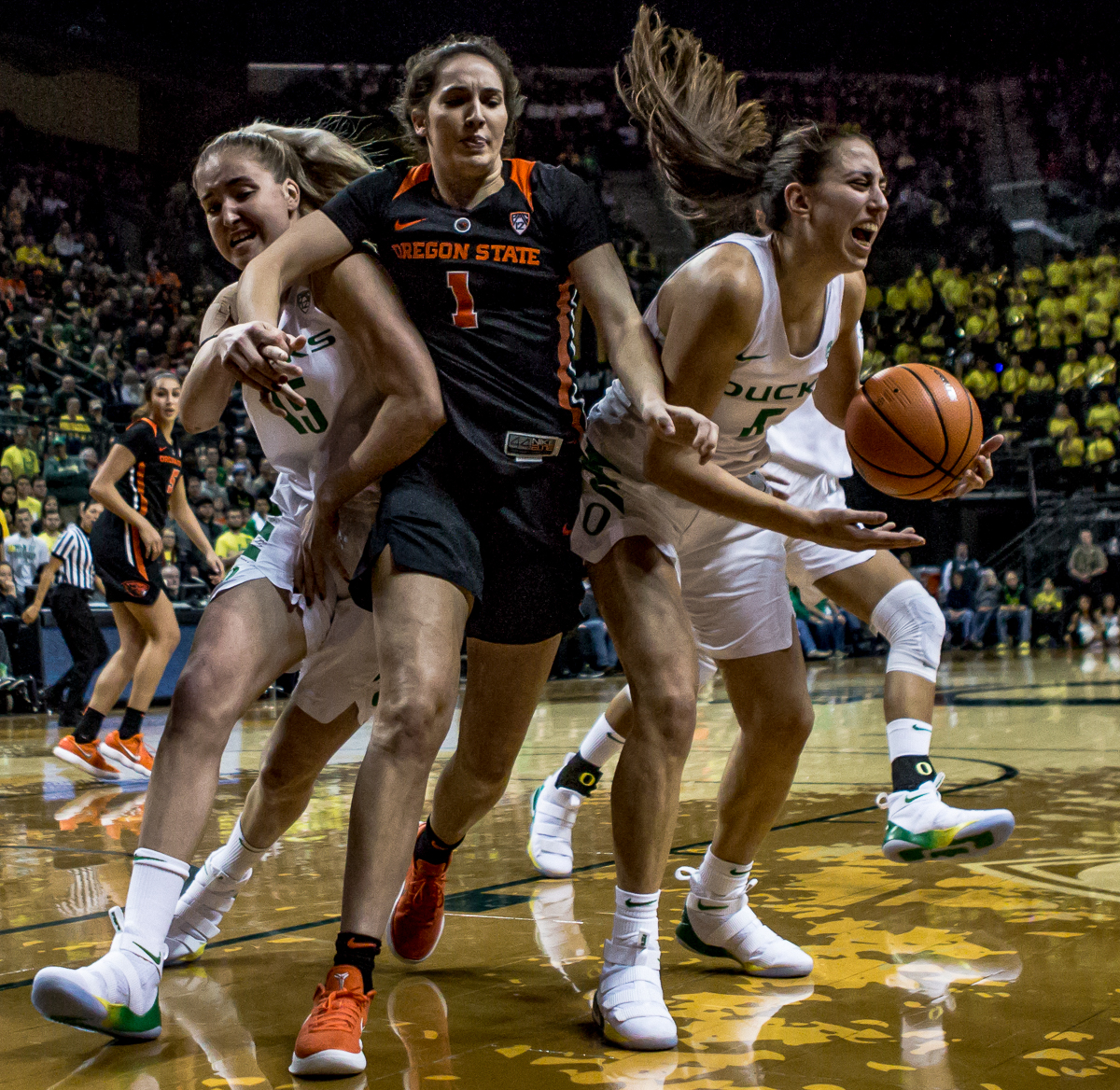 Oregon guard Maite Cazorla (#5) gains control of an Oregon State rebound. The Oregon Ducks defeated the Oregon State Beavers 75-63 on Sunday afternoon in front of a crowd of 7,249 at Matthew Knight Arena. The Ducks and Beavers split the two game Civil War with the Beavers defeating the Ducks on Friday night in Corvallis. The Ducks had four players in double digits: Satou Sabally with 21 points, Maite Cazorla with 16, Sabrina Ionescu with 15, and Mallory McGwire with 14. The Ducks shot 48.4% from the floor compared to the Beavers 37.3%. The Ducks are now 7-1 in conference play. Photo by Ben Lonergan, Oregon News Lab