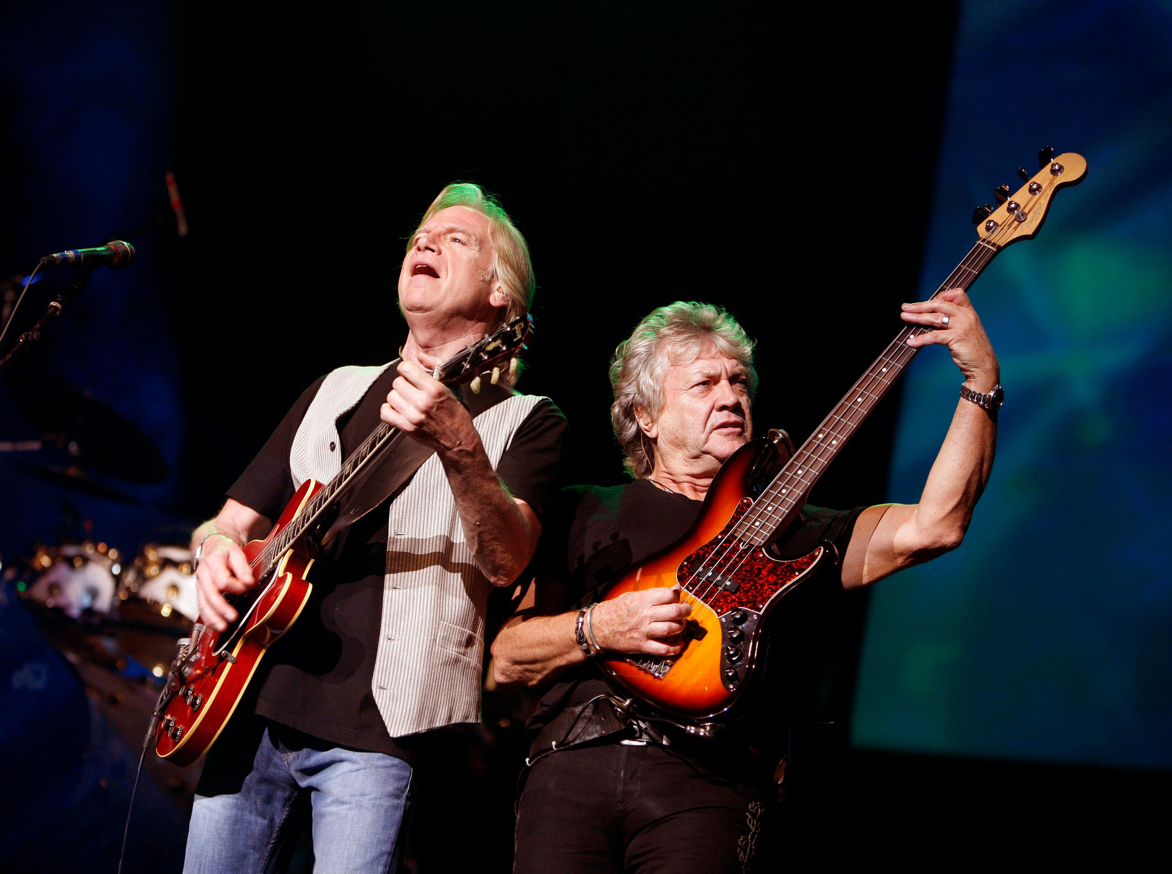 FILE - In this Aug. 20, 2009, file photo, guitarist Justin Hayward, left, and bassist John Lodge of The Moody Blues perform at Radio City Music Hall in New York. The Moody Blues will be inducted to the Rock and Roll Hall of Fame on April 14, 2018 in Cleveland, Ohio. (AP Photo/Jason DeCrow, File)