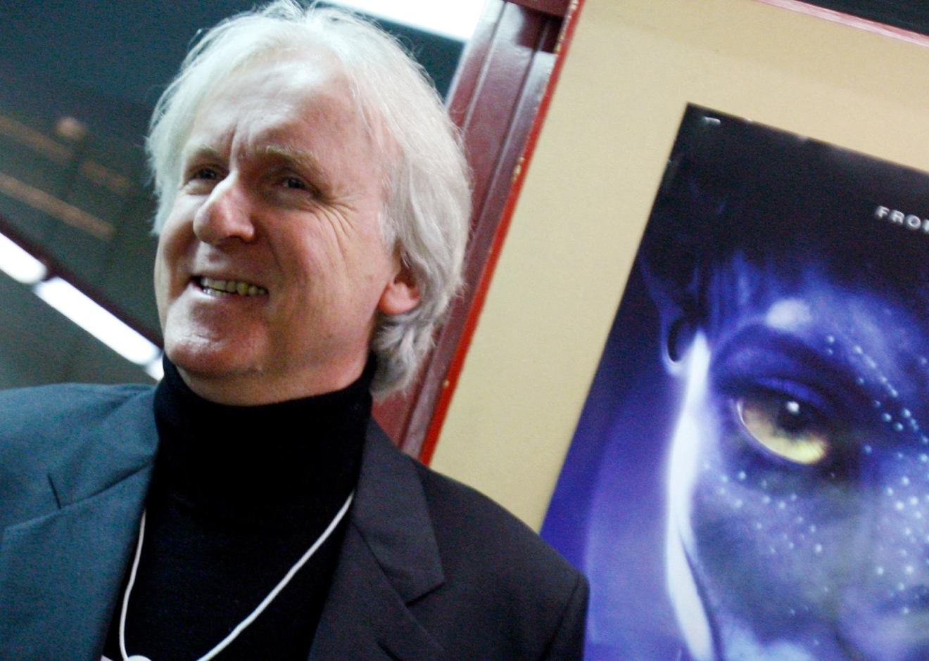 "FILE - In this Jan. 28, 2010, file photo, film director James Cameron poses for photos prior to the opening of the movie ""Avatar"" in Davos, Switzerland. Cameron says the long-awaited sequel to his science-fiction epic will not be released in 2018. (AP Photo/Virginia Mayo, File)"