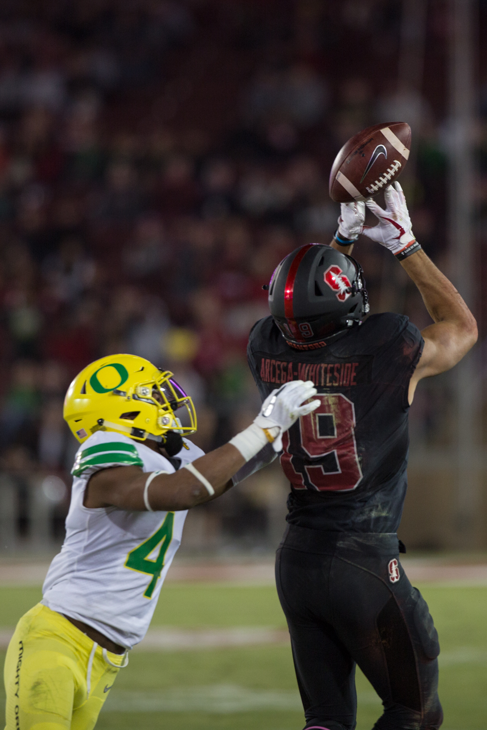 Stanford wide receiver JJ Arcega-Whiteside (#19) barely misses a deep pass while covered by Oregon cornerback Thomas Graham Jr. (#4).  The Oregon Ducks fell to the Stanford Cardinal 49-7 at Stanford Stadium, bringing their record to 4-3 for the season.  Photo by Austin Hicks, Oregon News Lab