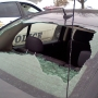 Police: Falling ice may have smashed window