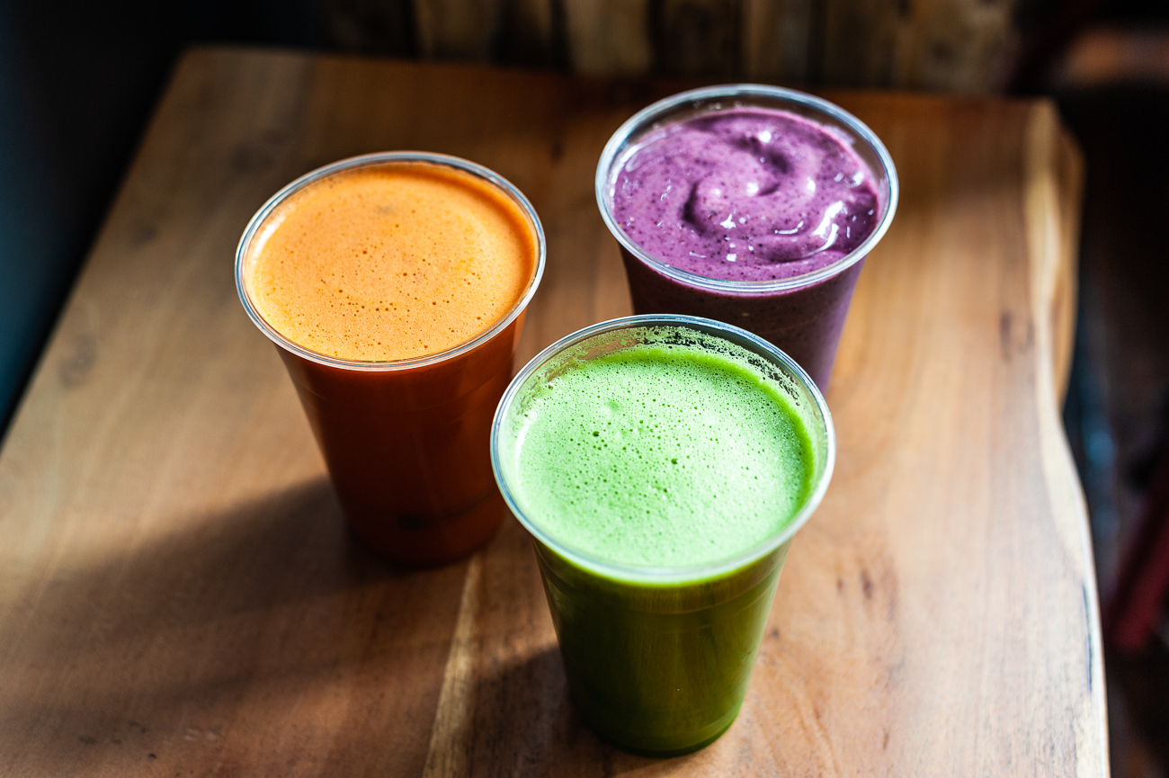 OMG! (Ohm my greens!) Juice (organic spinach, bok choy, cucumber, parsnip, organic celery, orange, organic apple, and organic ginger), Berry Good Smoothie (blueberry, pineapple, vanilla rice milk, avocado, stevia, and cinnamon), & Carrot Apple Juice / Image: Kellie Coleman // Published: 12.27.20