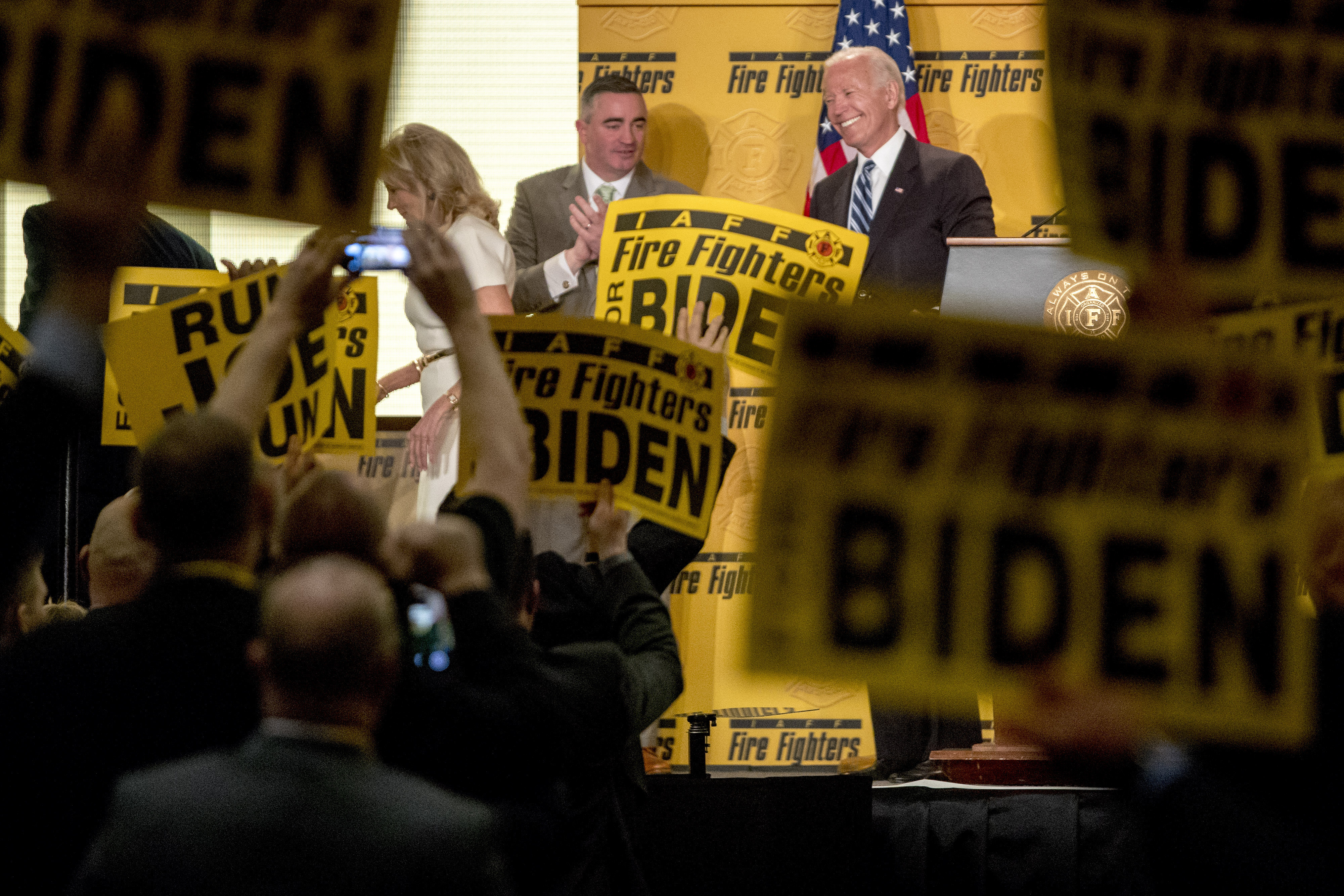 Former Vice President Joe Biden smiles as he exits the stage with his wife, former second lady Jill Biden, left, after speaking at the International Association of Firefighters at the Hyatt Regency on Capitol Hill in Washington, Tuesday, March 12, 2019, amid growing expectations he'll soon announce he's running for president. (AP Photo/Andrew Harnik)