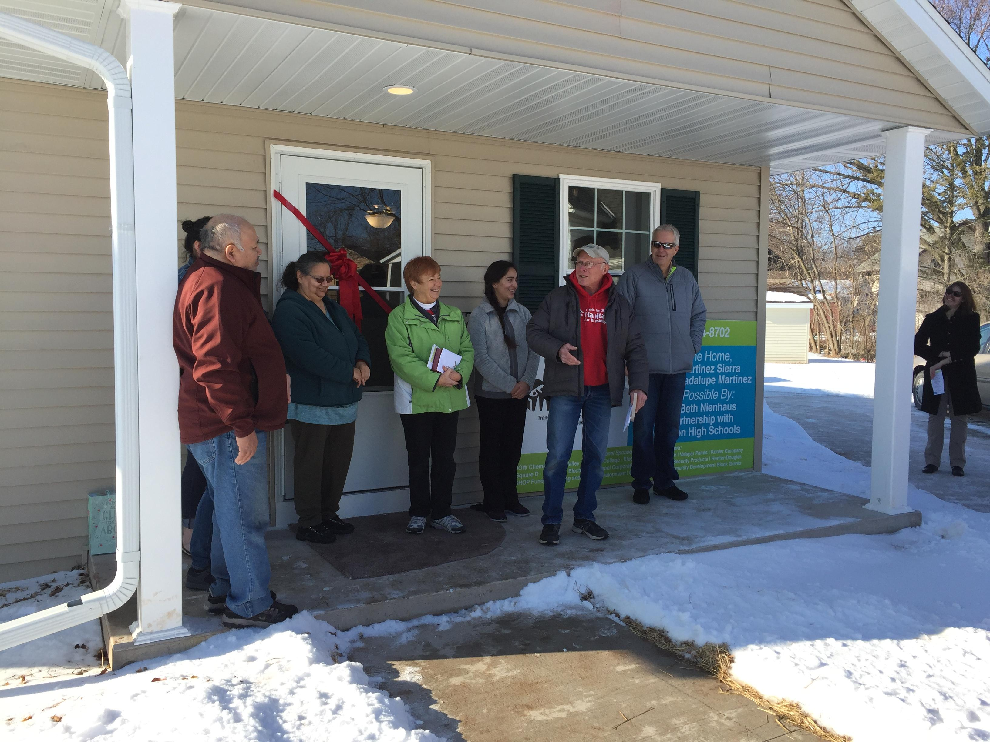 The Martinez Family gets the keys to their new home built by high school students through the Fox Cities Habitat for Humanity in Appleton, January 8, 2018. (WLUK)