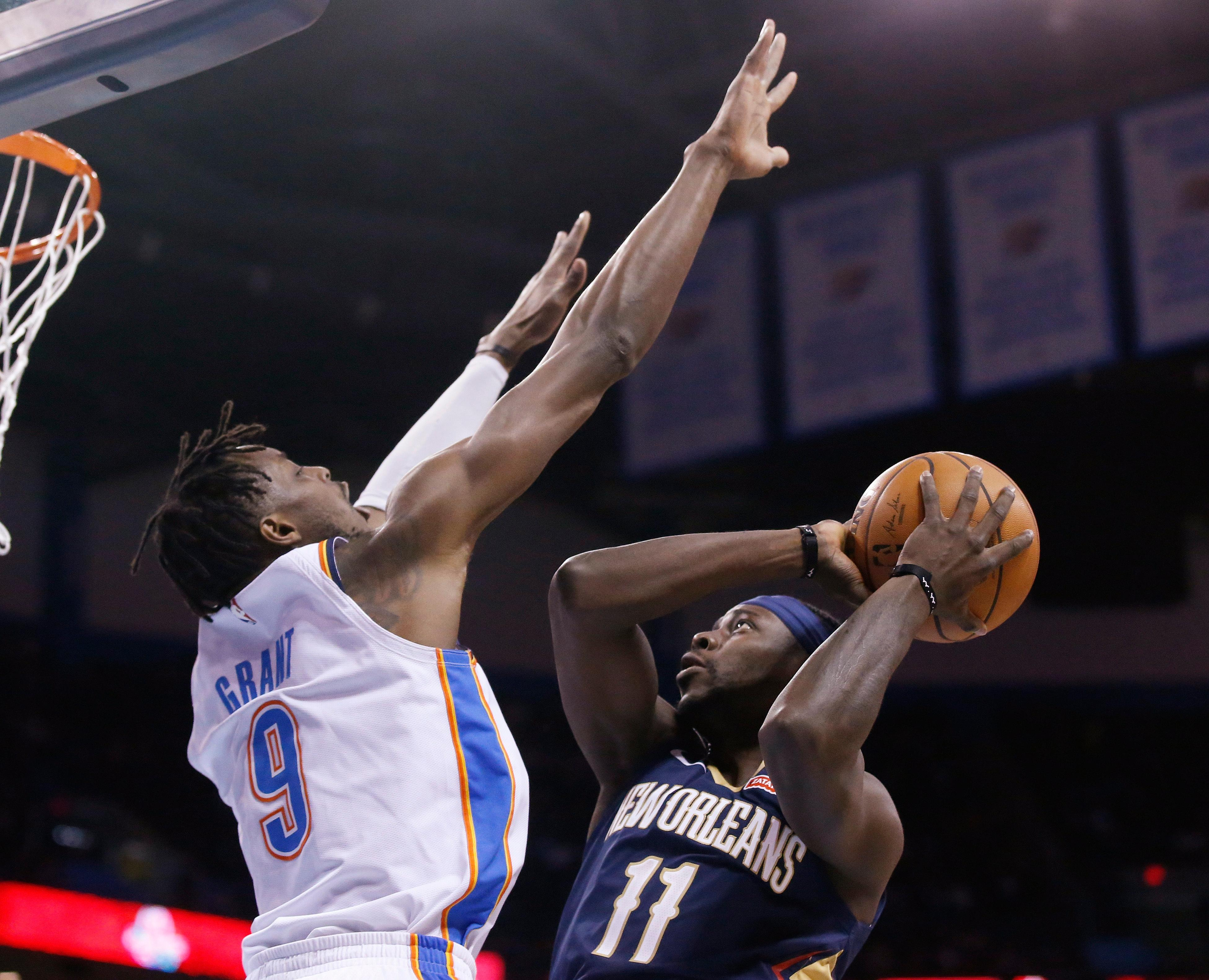 New Orleans Pelicans guard Jrue Holiday (11) shoots as Oklahoma City Thunder forward Jerami Grant (9) defends during the first half of an NBA basketball game in Oklahoma City, Thursday, Jan. 24, 2019. (AP Photo/Sue Ogrocki)
