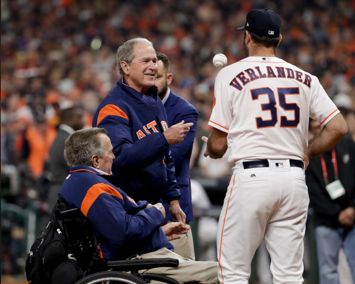 Houston Astros' Justin Verlander greets Former President George H.W. Bush after George W. Bush threw the ceremonial first pitch before Game 5 of baseball's World Series against the Los Angeles Dodgers Sunday, Oct. 29, 2017, in Houston. (AP Photo/Matt Slocum)