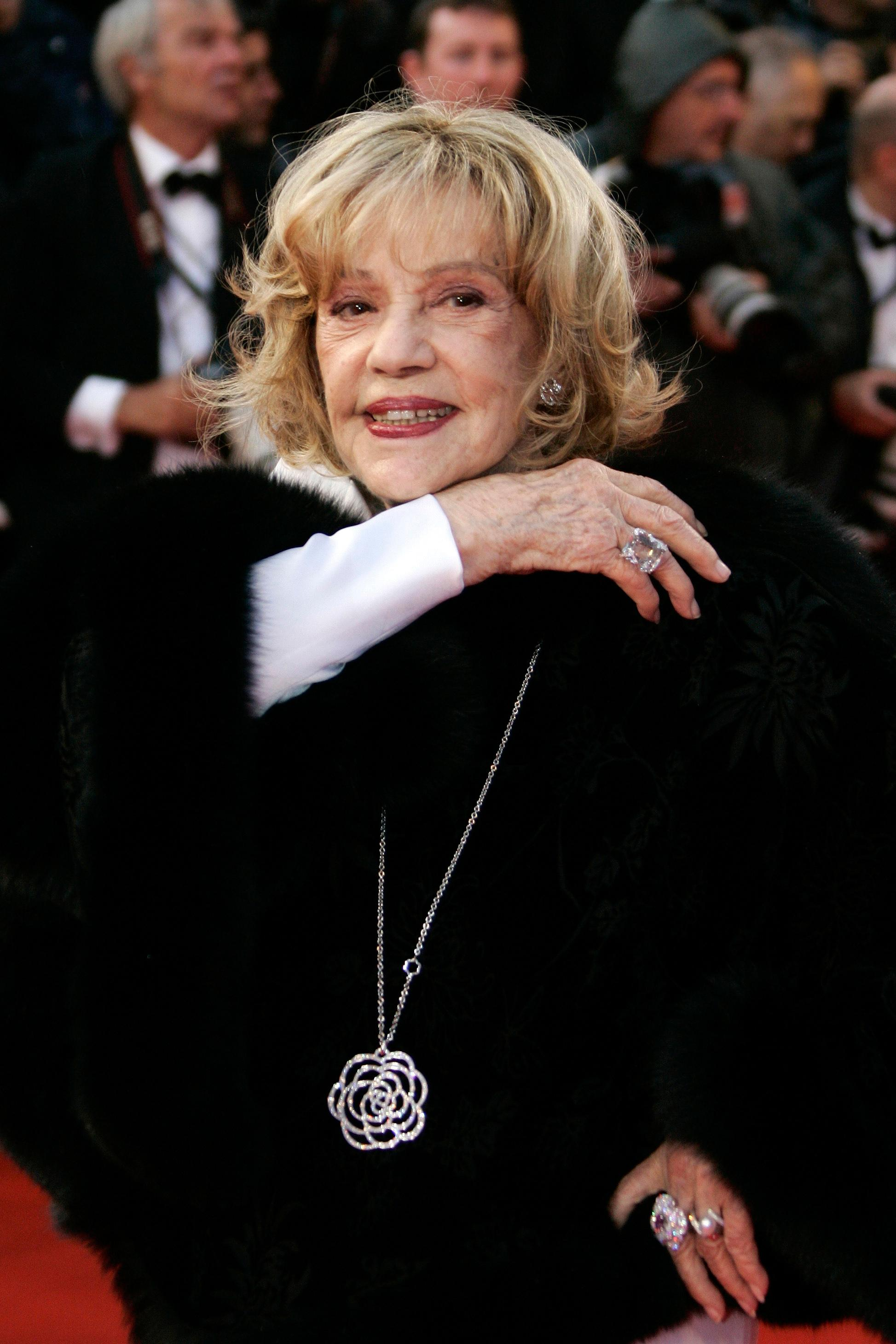 "FILE - In this Saturday, May 17, 2008 file photo French actress Jeanne Moreau arrives to the premiere of the film ""Vicky Cristina Barcelona"" during the 61st International film festival in Cannes, southern France. French actress Jeanne Moreau, whose seven-decade career included work with Francois Truffaut, Orson Welles, Wim Wenders and other acclaimed directors, has died aged 89 it was announced Monday July 31, 2017. (AP Photo/Francois Mori, File)"