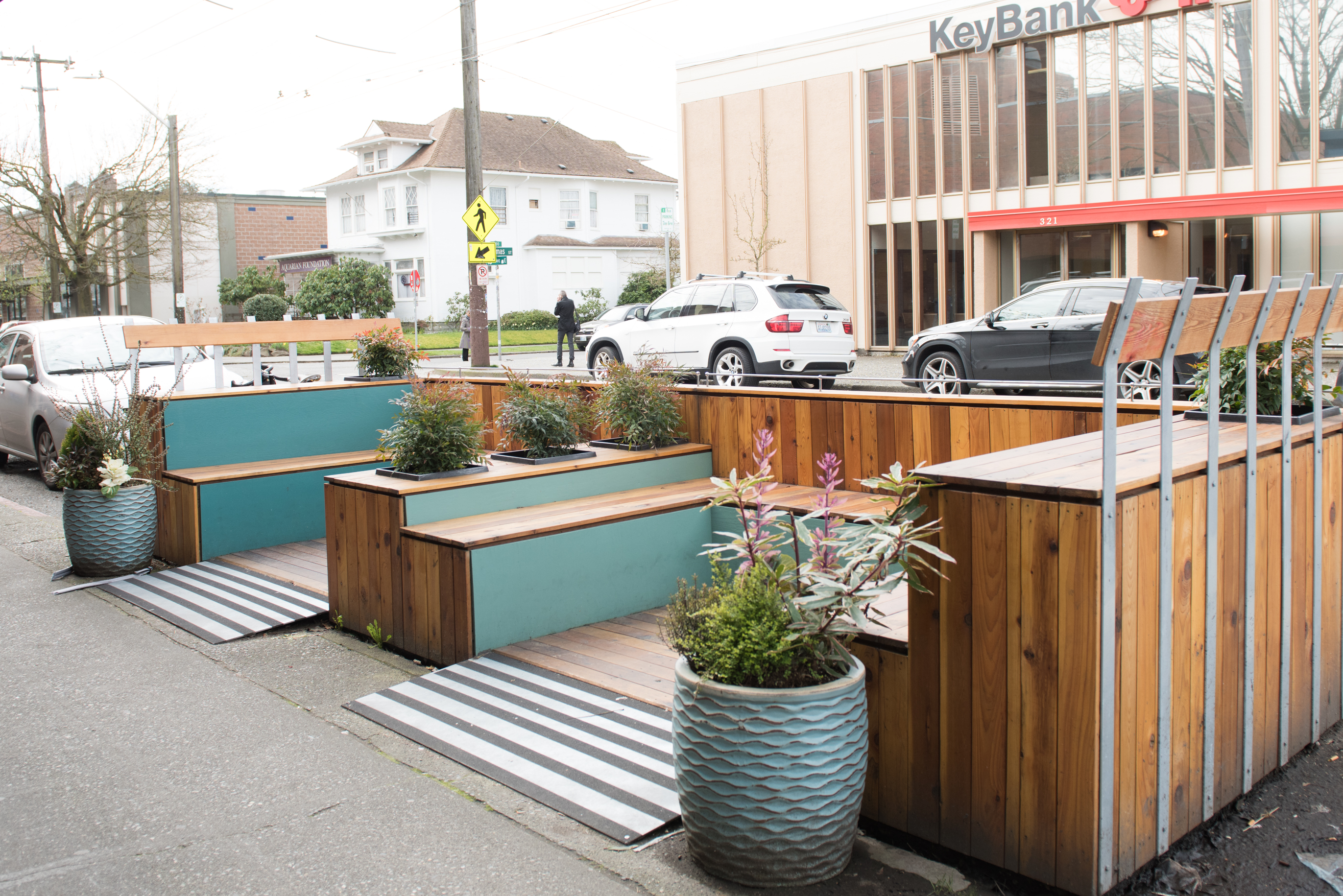 Sugar Plum Parklet; Outside Sugar Plum, a sweet shop with a vegan twist, sits a new parklet with teal green benches, tidy planters and plenty of bicycle parking. (Image: Natalia Dotto)