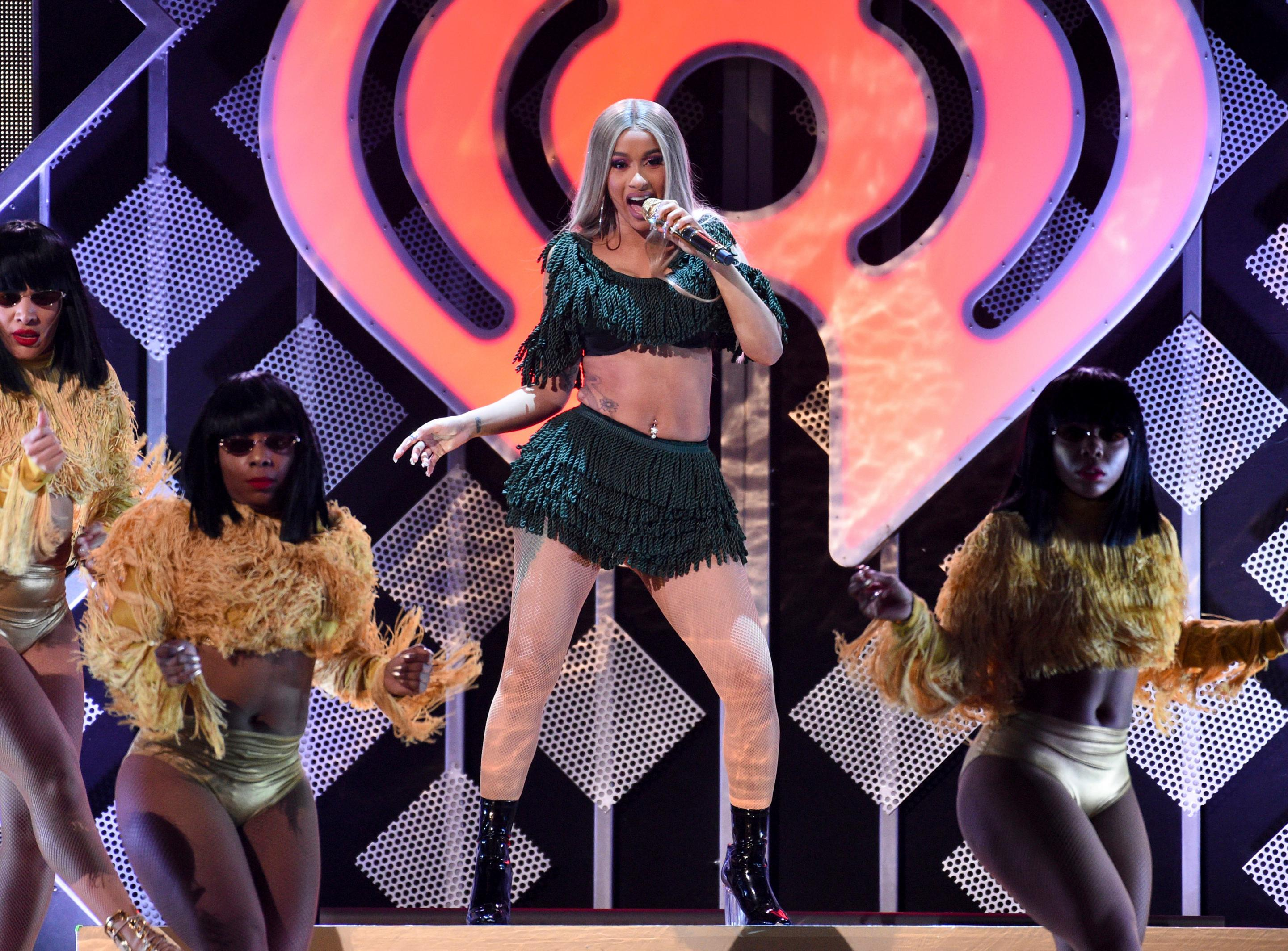 FILE - In this Dec. 7, 2018 file photo, hip-hop recording artist Cardi B performs at Z100's iHeartRadio Jingle Ball in New York.(Photo by Evan Agostini/Invision/AP, File)