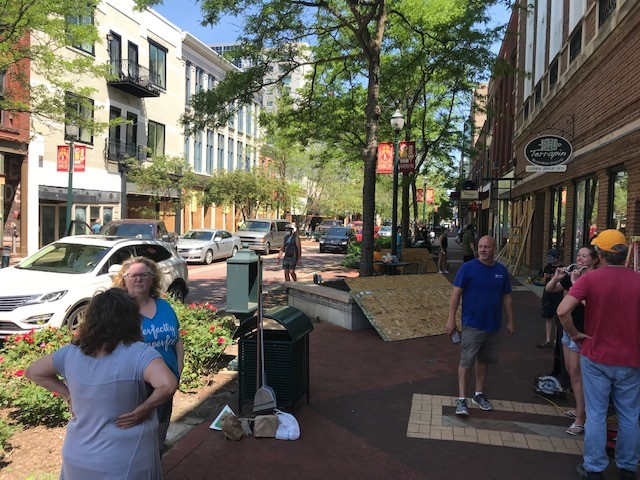 Volunteers pitch in to help downtown store owners clean up and board up their shops Tuesday, June 2, 2020, as Kalamazoo city officials prepare for another night of unrest. (WWMT/Keith Thompson)