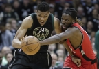 Toronto Raptors' DeMarre Carroll and Milwaukee Bucks' Giannis Antetokounmpo go after a loose ball during the second half of game 3 of their NBA first-round playoff game Thursday, April 20, 2017, in Milwaukee.