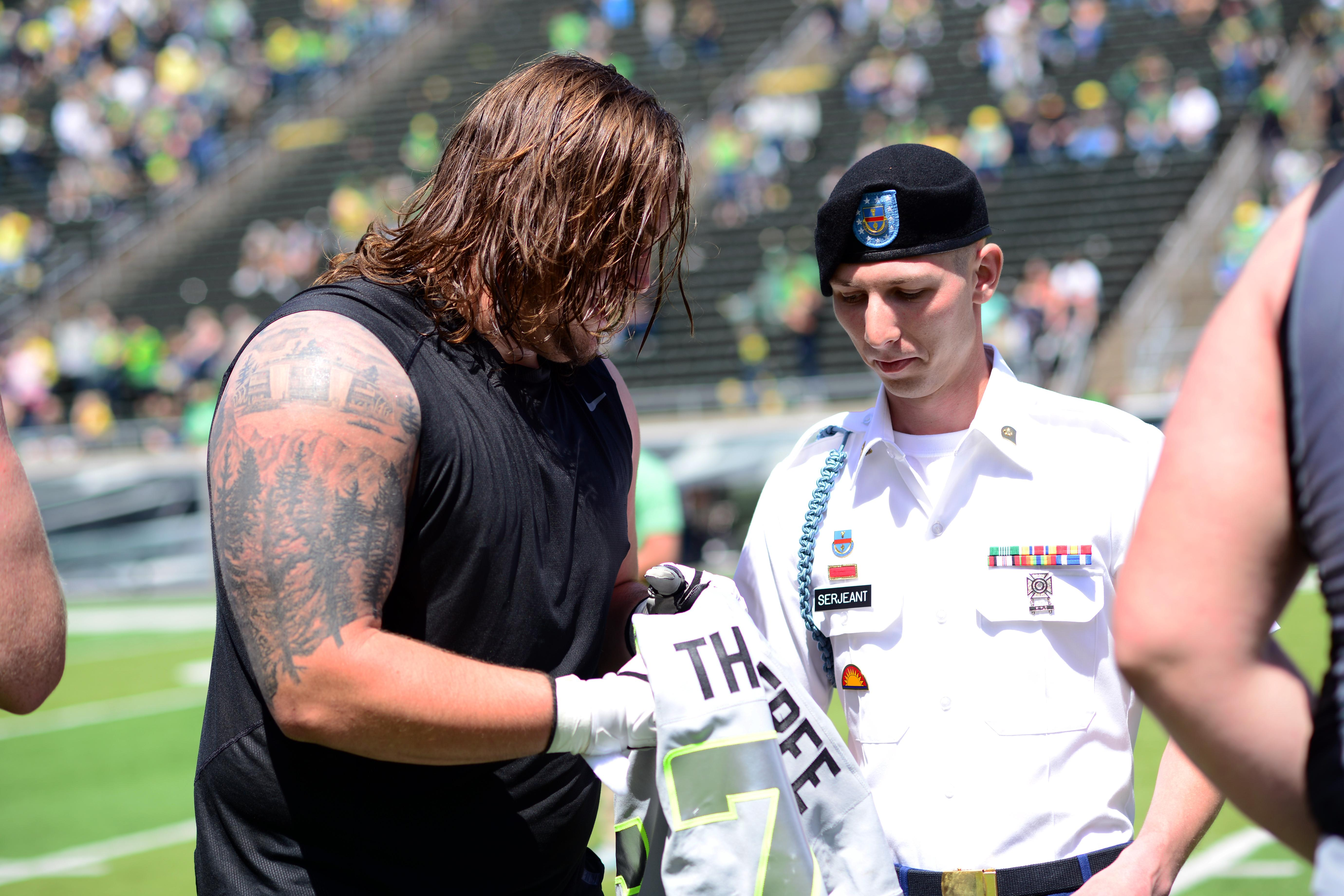 University of Oregon football players give their jerseys to members of the Oregon National Guard, along with Veterans from every branch of service, after the Spring Game, April 29, 2017, at Autzen Stadium in Eugene, Oregon. The players spent time getting to know the Veterans and gave them a tour of their training facilities. (Photo by Sgt. 1st Class April Davis, Oregon Military Department Public Affairs)