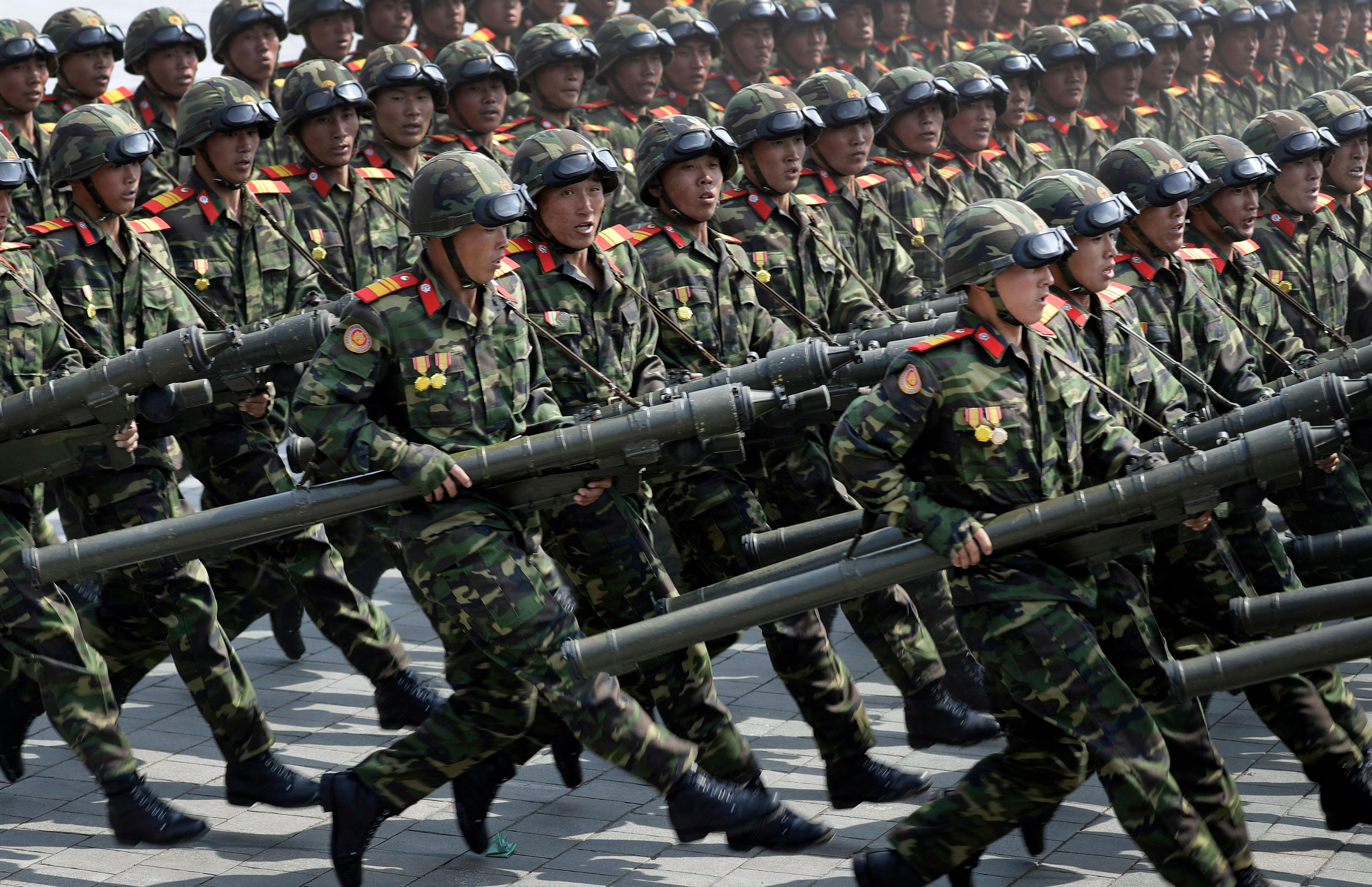 In this April 15, 2017, photo, soldiers carrying rockets march across Kim Il Sung Square during a military parade to celebrate the 105th birth anniversary of Kim Il Sung in Pyongyang, North Korea. Fresh off an immense North Korean parade that revealed an arsenal of intercontinental ballistic missiles, rival South Korea and its allies are bracing for the possibility that Pyongyang's follow-up act will be even bigger. (AP Photo/Wong Maye-E)