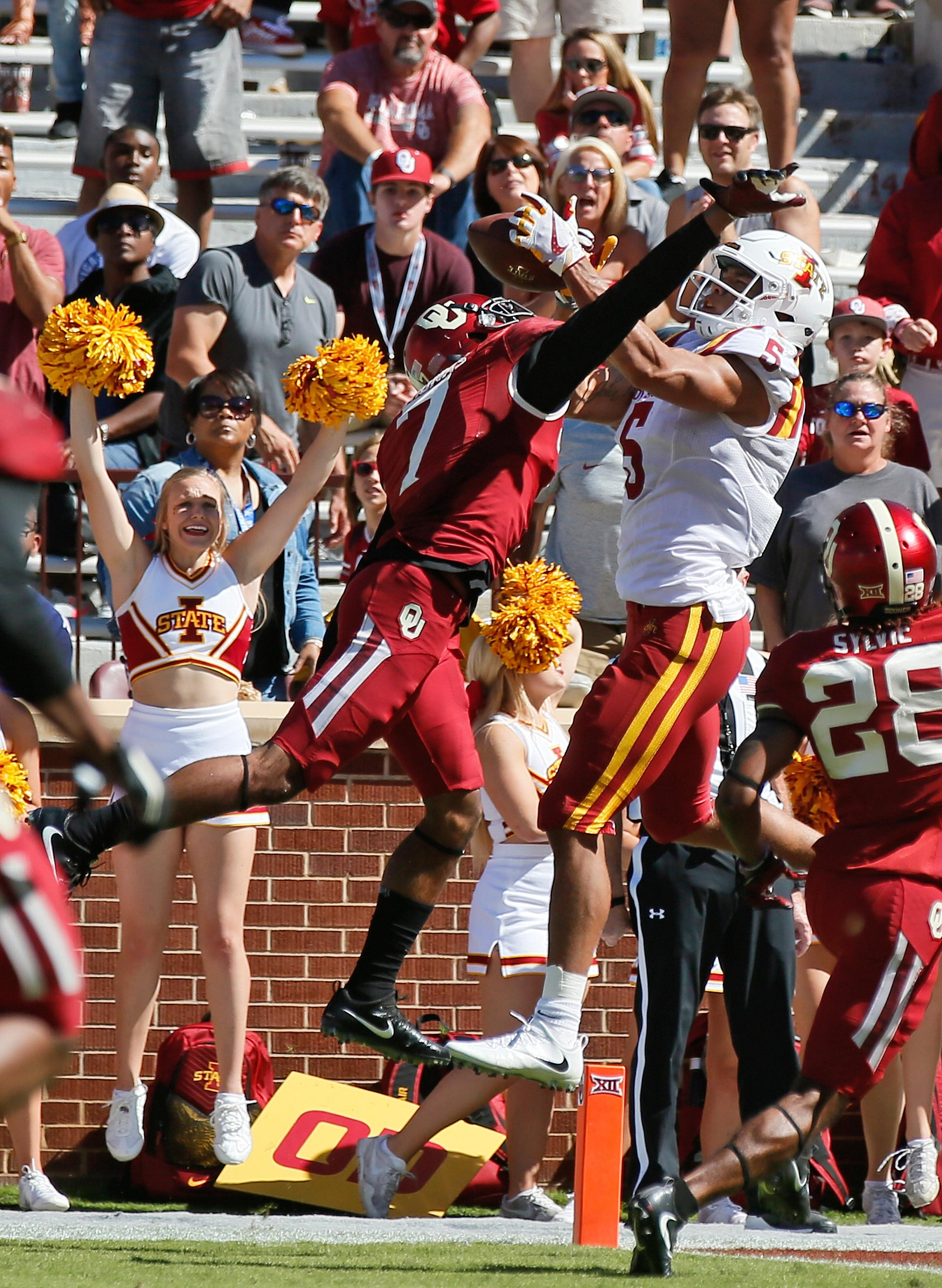 Iowa State wide receiver Allen Lazard (5) catches the game winning touchdown between Oklahoma cornerback Jordan Thomas (7) and safety Chanse Sylvie (28) in the fourth quarter of an NCAA college football game in Norman, Okla., Saturday, Oct. 7, 2017. Iowa State won 38-31. (AP Photo/Sue Ogrocki)