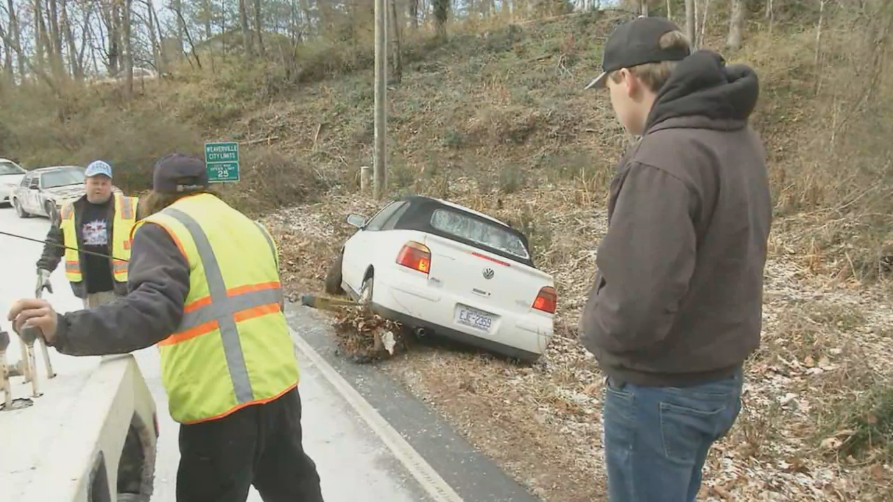 The new year brought a busy day for towing companies across the mountains. News 13 talked to several who were slammed with calls to rescue abandoned cars from Sunday's storm. (Photo credit: WLOS Staff)