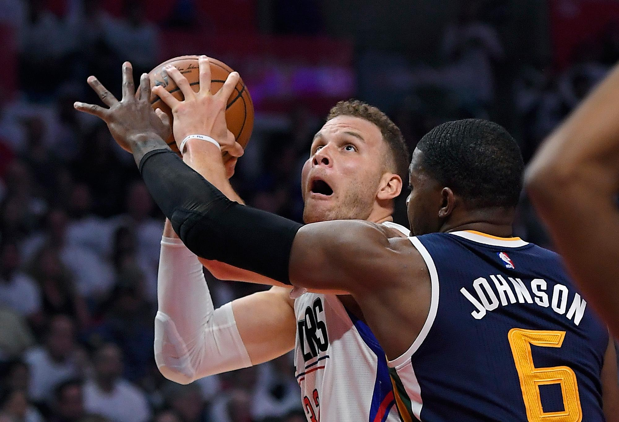 Los Angeles Clippers forward Blake Griffin, left, shoots as Utah Jazz forward Joe Johnson defends during the second half in Game 1 of an NBA basketball first-round playoff series, Saturday, April 15, 2017, in Los Angeles. The Jazz won 97-95. (AP Photo/Mark J. Terrill)
