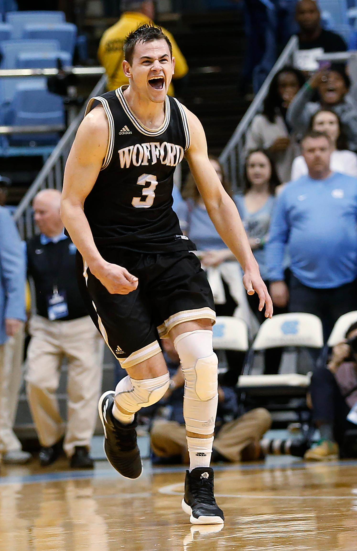 Wofford's Fletcher Magee reacts after Wofford defeated  North Carolina 79-75 in an NCAA college basketball game in Chapel Hill, N.C., Wednesday, Dec. 20, 2017. (AP Photo/Ellen Ozier)