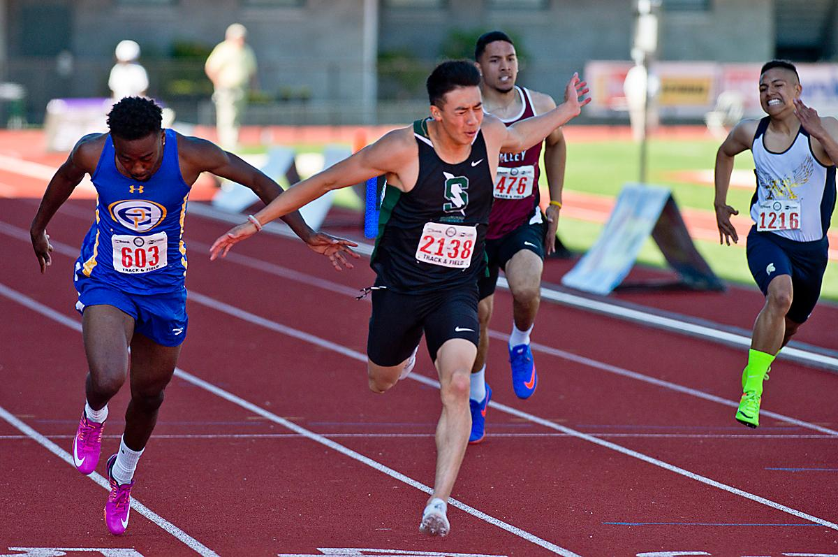 Brayden Durfee from Summit wins the 5A Boys 200 meter Dash with a time of 21.81 at the OSAA Championship at Hayward Field this Saturday. Photo by Dan Morrison, Oregon News Lab