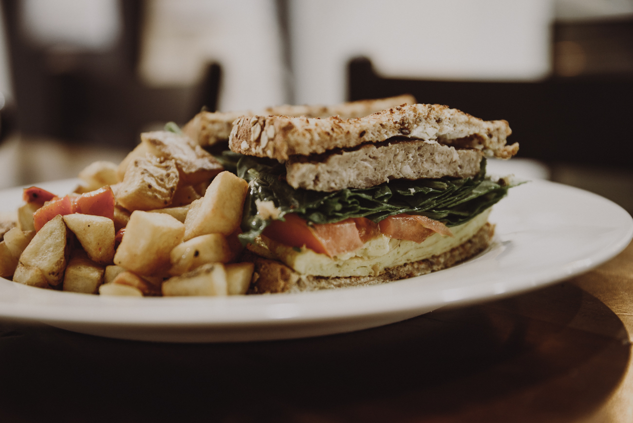 <p>The Pro Sandwich: two eggs, sausage, goat cheese, sprouts, avocado, and tomato on wheat bread / Image: Brianna Long // Published: 9.12.18</p>