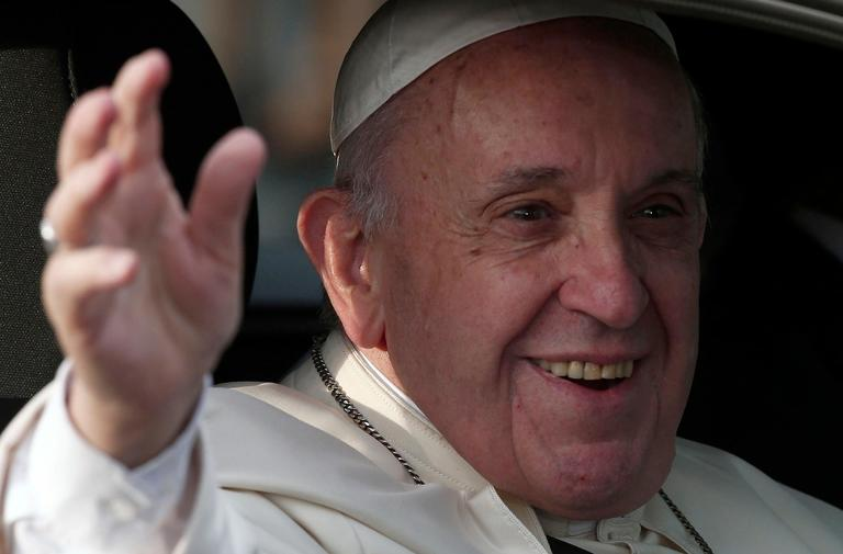 Pope Francis waves as he arrives at the San Luis Beltran church on his way to the Apostolic Nunciature in Santiago, Chile, Monday, Jan. 15, 2018. Francis flew in to Chile's capital Monday night for a visit expected to be met with protests over sexual abuse by priests and confronted by many Chileans deeply skeptical about the Roman Catholic Church. (AP Photo/Luis Hidalgo)