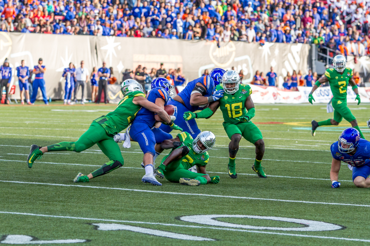 Oregon defensive end Jalen Jelks (#97) brings down Boise State running back Ryan Wolpin (#21). The Boise State Broncos defeated the Oregon Ducks 38 to 28 in the 2017 Las Vegas Bowl at Sam Boyd Stadium in Las Vegas, Nevada on Saturday December 17, 2017. The Las Vegas Bowl served as the first test for Oregon's new Head Coach Mario Cristobal following the loss of former Head Coach Willie Taggart to Florida State University earlier this month. Photo by Ben Lonergan, Oregon News Lab