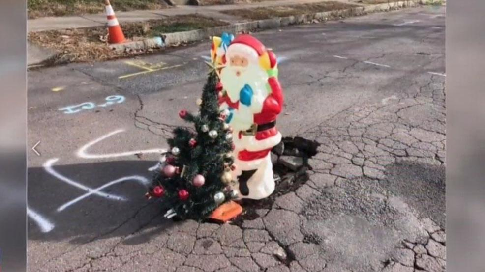 Locals Fill Wilkes Barre Pothole With Santa Christmas Tree