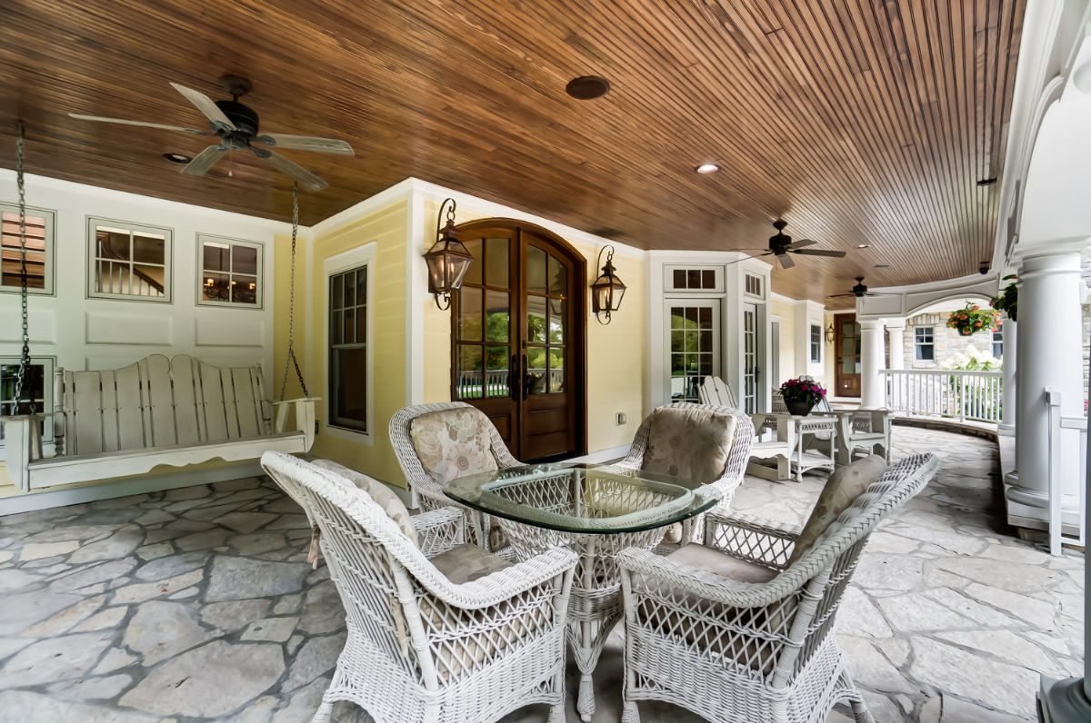 The grounds are beautifully landscaped, and everywhere you look you'll see trees. A huge covered porch, multiple patios and comfortable outdoor nooks, as well as a rolling green lawn will let you, your guests, your kids, and your pets enjoy the surrounding nature. And a four-car garage completes the package. / Image courtesy of Wow Video Tours via Michael Franz of Coldwell Banker West Shell-Hyde Park // Published: 9.7.20