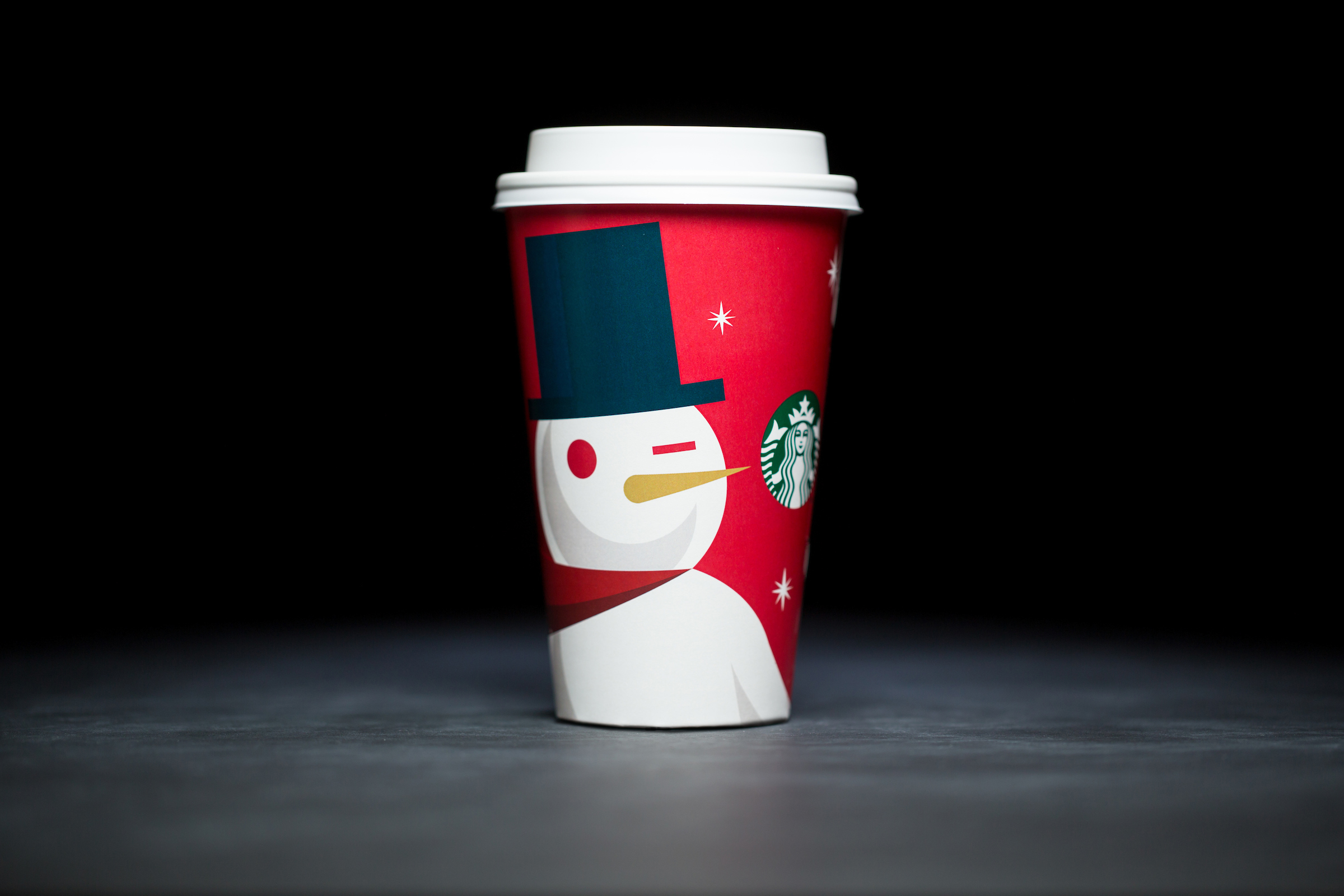 2012: For 20 years, Starbucks have released a range of holiday cup designs, most of them based around their world famous red cup. It's not easy to find the very first Starbucks holiday cups, which made their debut in stores in 1997. Few were saved, and electronic design files were lost in an earthquake in 2001. Even an Internet search is unyielding, with the cups having made their arrival long before the first selfie. But, we have them here! Click on for a photos of all 20 holidays cup designs. (Image: Joshua Trujillo/Cover Images)