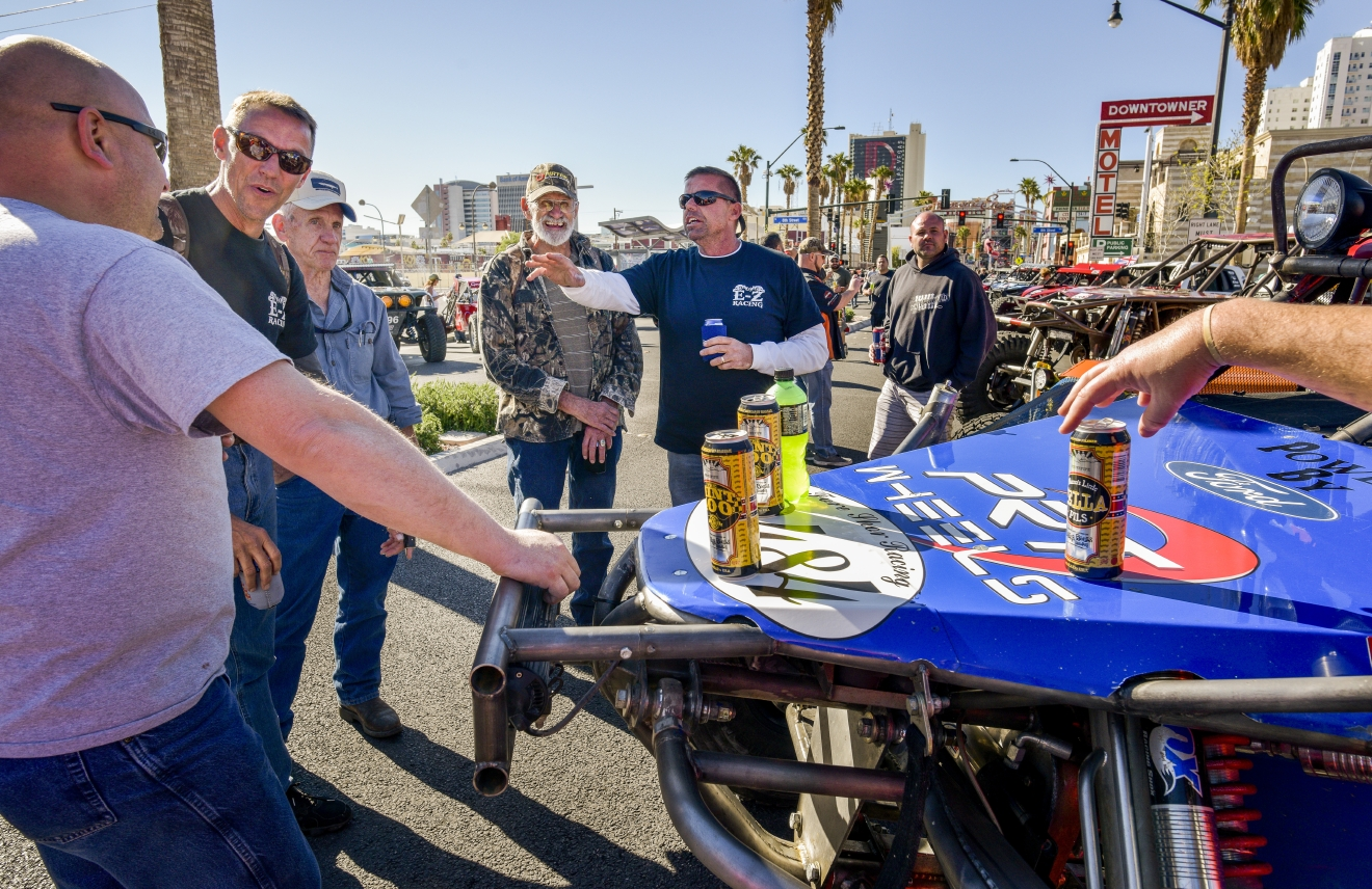 Drivers and crew gather to talk racing following the Mint 400 4 Wheel Parts Vehicle Procession powered by Odyssey Battery in downtown Las Vegas along Fremont Street East at the kick off of the Mint 400 off-road race weekend on Wednesday, Mar. 1, 2017. [Mark Damon/Las Vegas News Bureau]