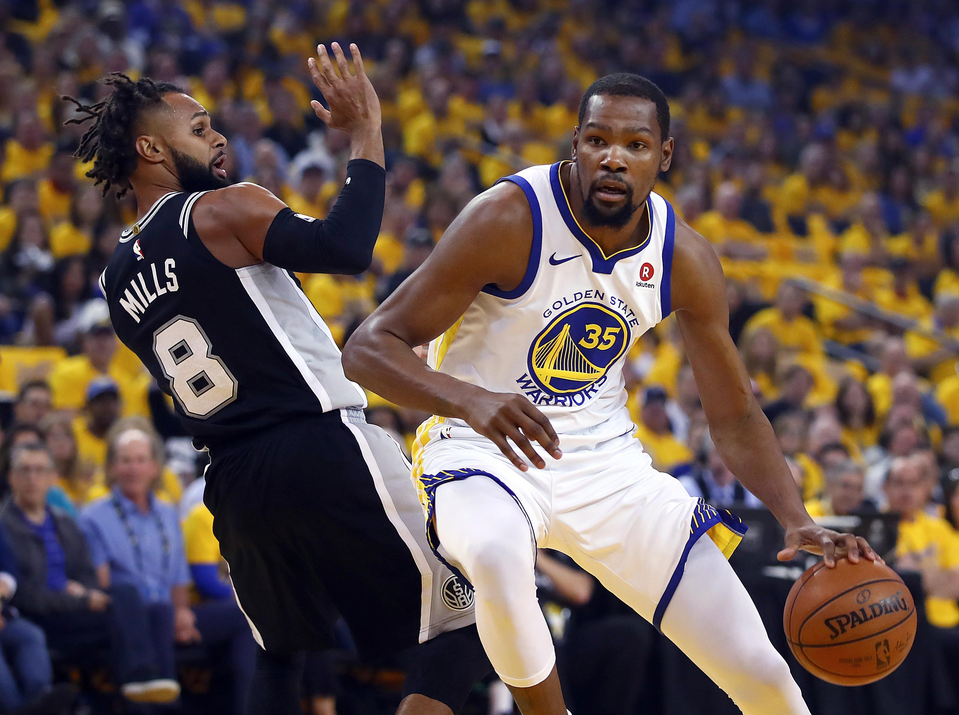 Golden State Warriors Kevin Durant Right Drives The Ball Around San Antonio Spurs