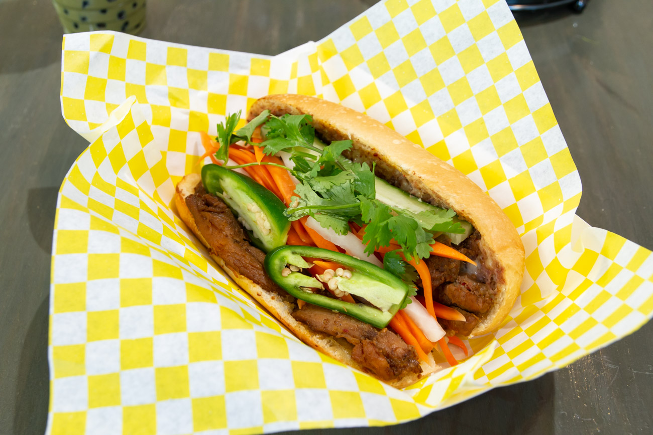 Chicken banh mi is served in a fresh baguette with homemade butter and pate and stuffed with cucumber, pickled carrots, daikon, cilantro, and jalapenos. / Image: Elizabeth A. Lowry // Published: 1.2.20